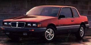 1985 Pontiac Grand Am  - By its third ITERATION, the Grand Am finally achieves success on the sales charts. For anyone who appriciates good design, that's enough to make you weep. ( www.cargurus.com )