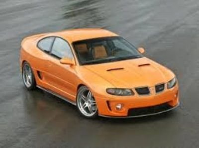 THE  2000 PONTIAC GTO  WAS THUNDER FROM DOWN UNDER. IN A HEROIC EFFORT TO RECESSITATE A ONCE PROUD BRAND - ONE THAT HAD BEEN LEFT FOR DEAD ON THE SIDE OF THE ROAD, BOB LUTZ - THE ULTIMATE DETROIT CAR GUY - WENT TO AUSTRALIA TO BRING STATESIDE THE FANTASTIC  HOLDEN MORANO GT  . IT SEEMS THE GM-ERS FROM OZZIE HADN'T FORGOTTEN WHAT A MUSCLECAR LOOKED OR FELT LIKE. ( www.fastlaps.com )