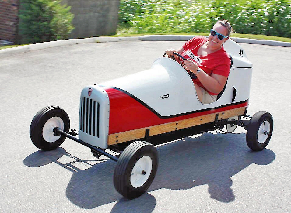 The Kreinbrink Family's collection of King Midgets including a pair of retored Model Is. Here's Felicia Kreinbrink at the wheel at the 2016 King Midget Jamboree…embodying the joys of the King Midget A happy King Midget owner at the 2016 King Midget Jamboree ( www.kingmidgetcarclub.org )