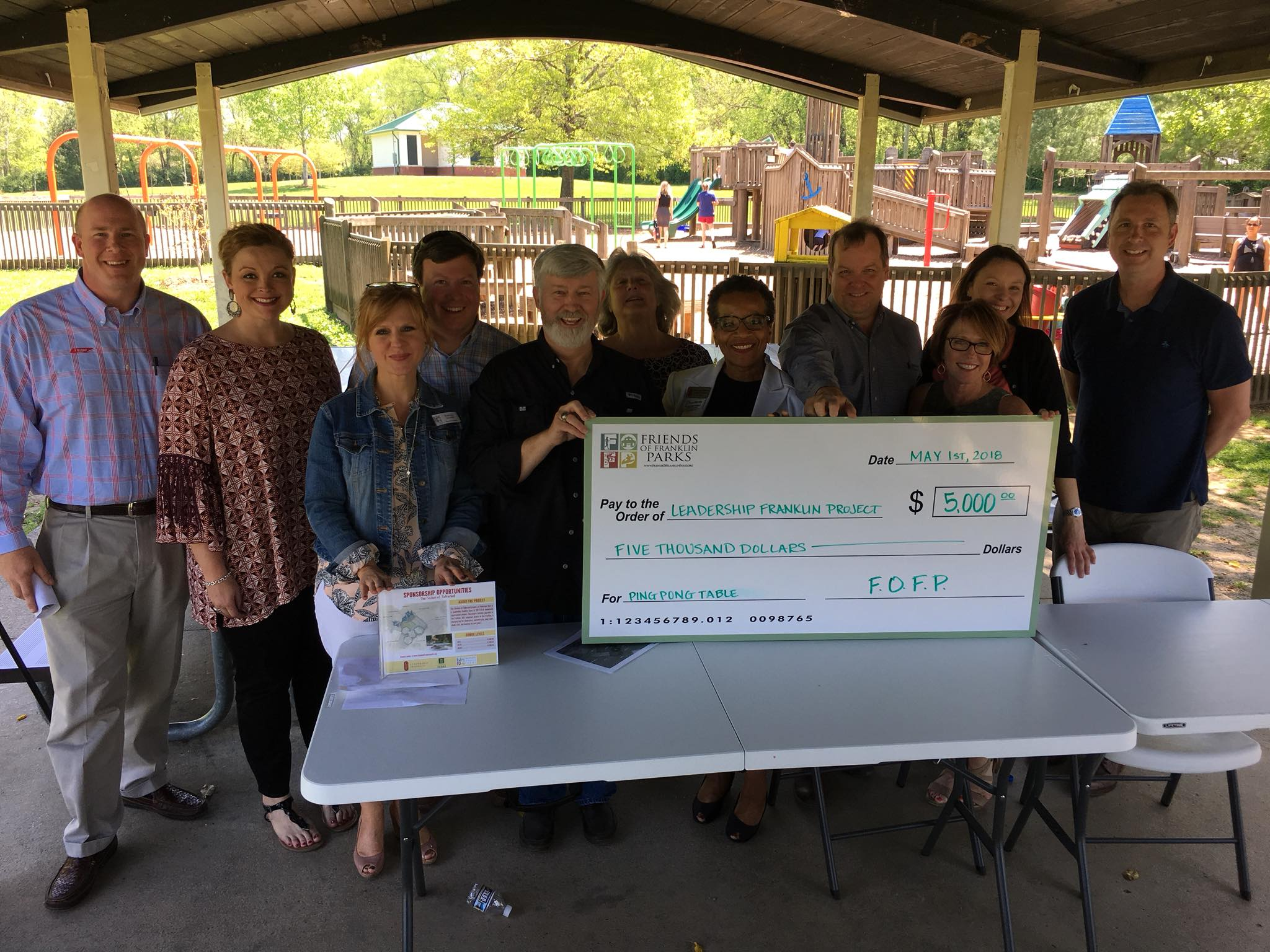 The Friends of Franklin Parks presents a check to the Leadership Franklin Project to fund an outdoor ping pong table for Pinkerton Park.