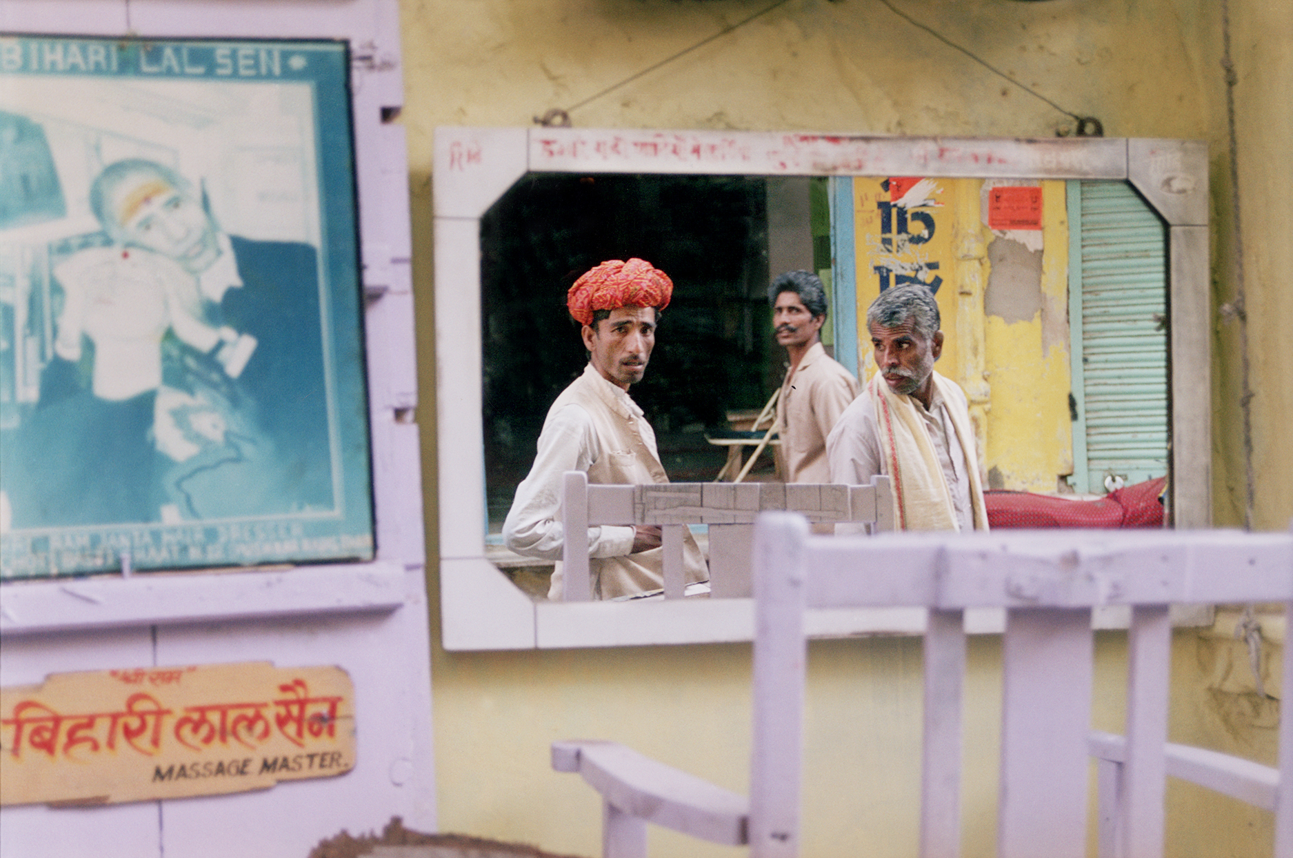 Reflection of a man walking down the street in Pushkar, India. By Jessica Scranton