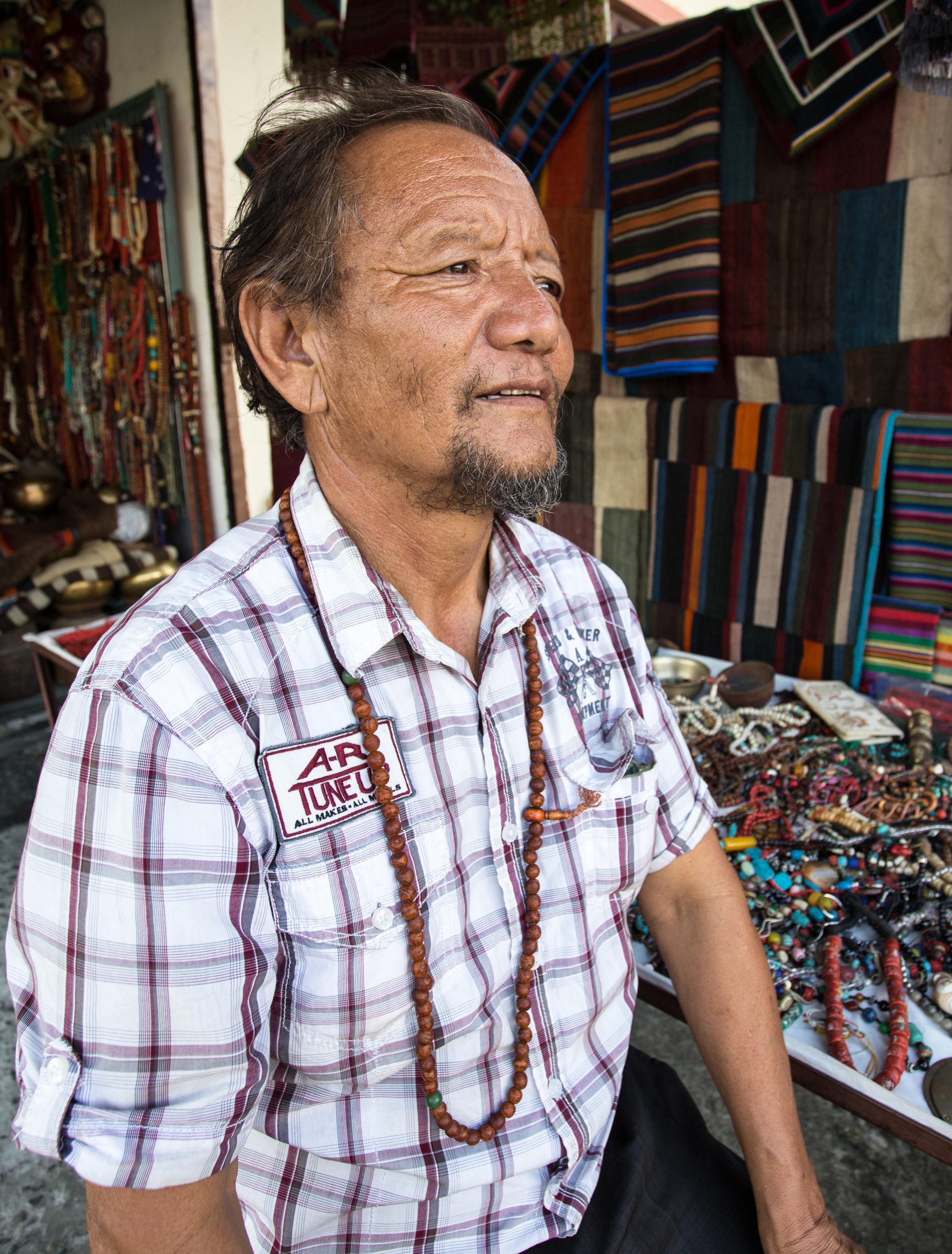 Tibetan refugee shop owner.