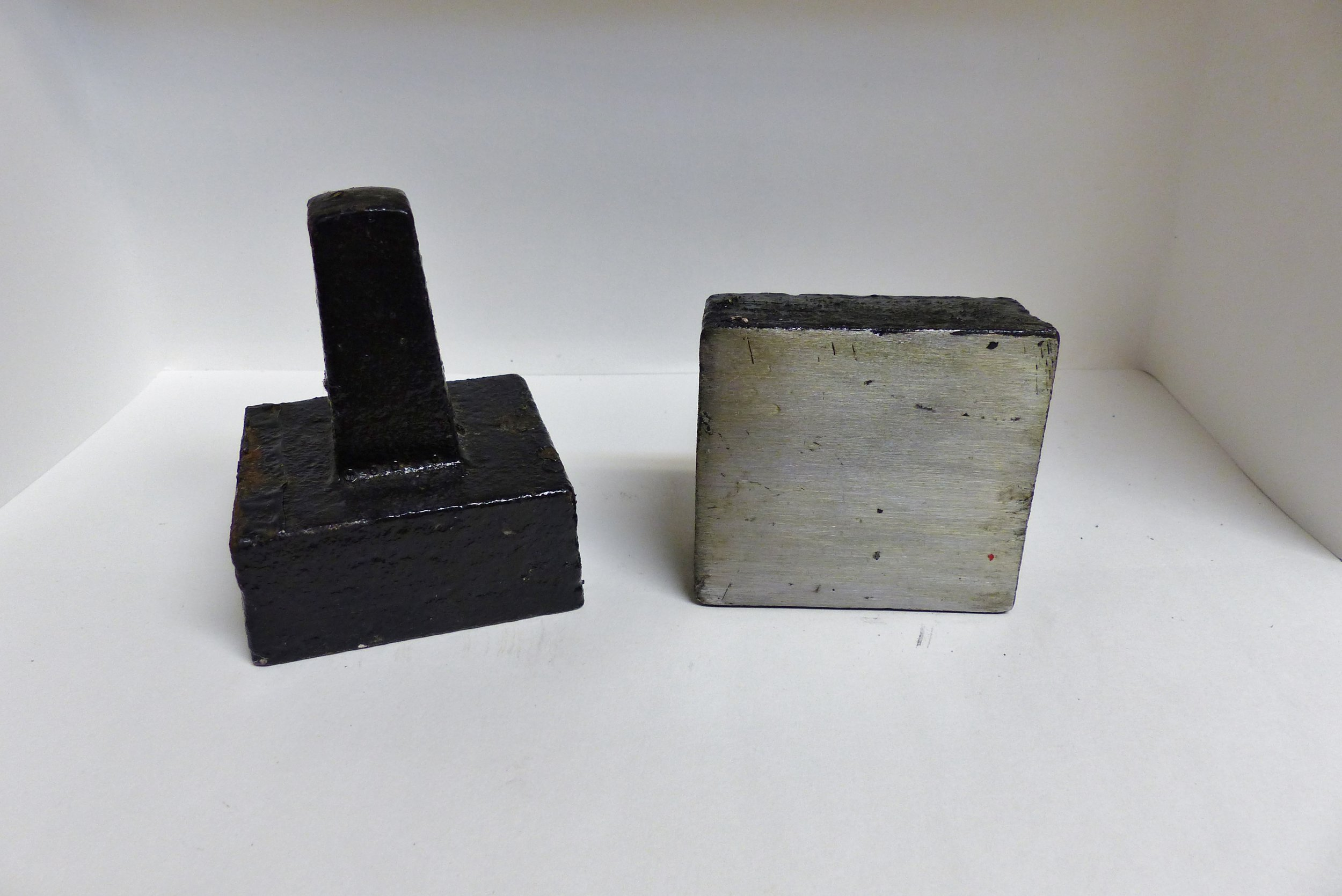 "Shorter Rectangular Stake Anvil   FACE: 2.5"" x 2.75"" THICKNESS: 1.8"" TANG LENGTH: 2.25"" STEM TAPER: 1"" under face to 3/4"" square at bottom WEIGHT: 2 lbs. PRICE: $58.00  FREE shipping anywhere in the USA! Delivered by USPS Priority Mail  Toll Free Order Line: 888-737-5714"