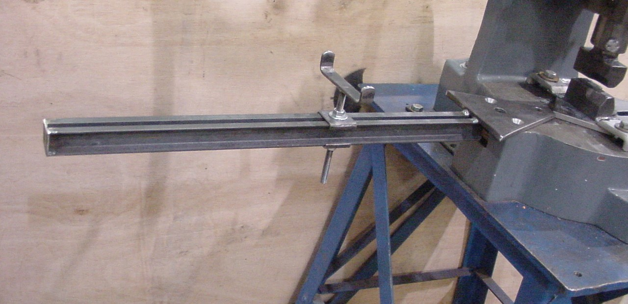 This is an adjustable support. It is very handy for resting the longer pieces of stock on while you work the ends.
