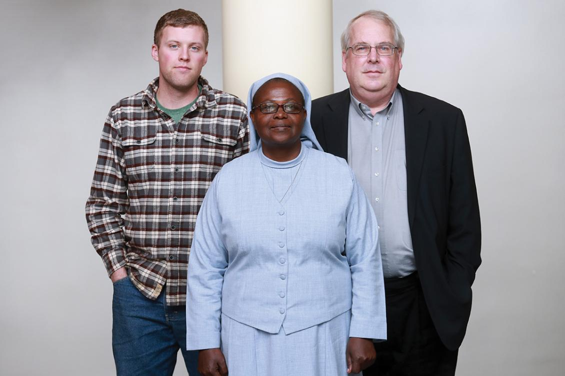 Andrew McAferty, '16, Sister Elizabeth Namazzi and Jim Dooley, '76. Photo courtesy of Seattle University.