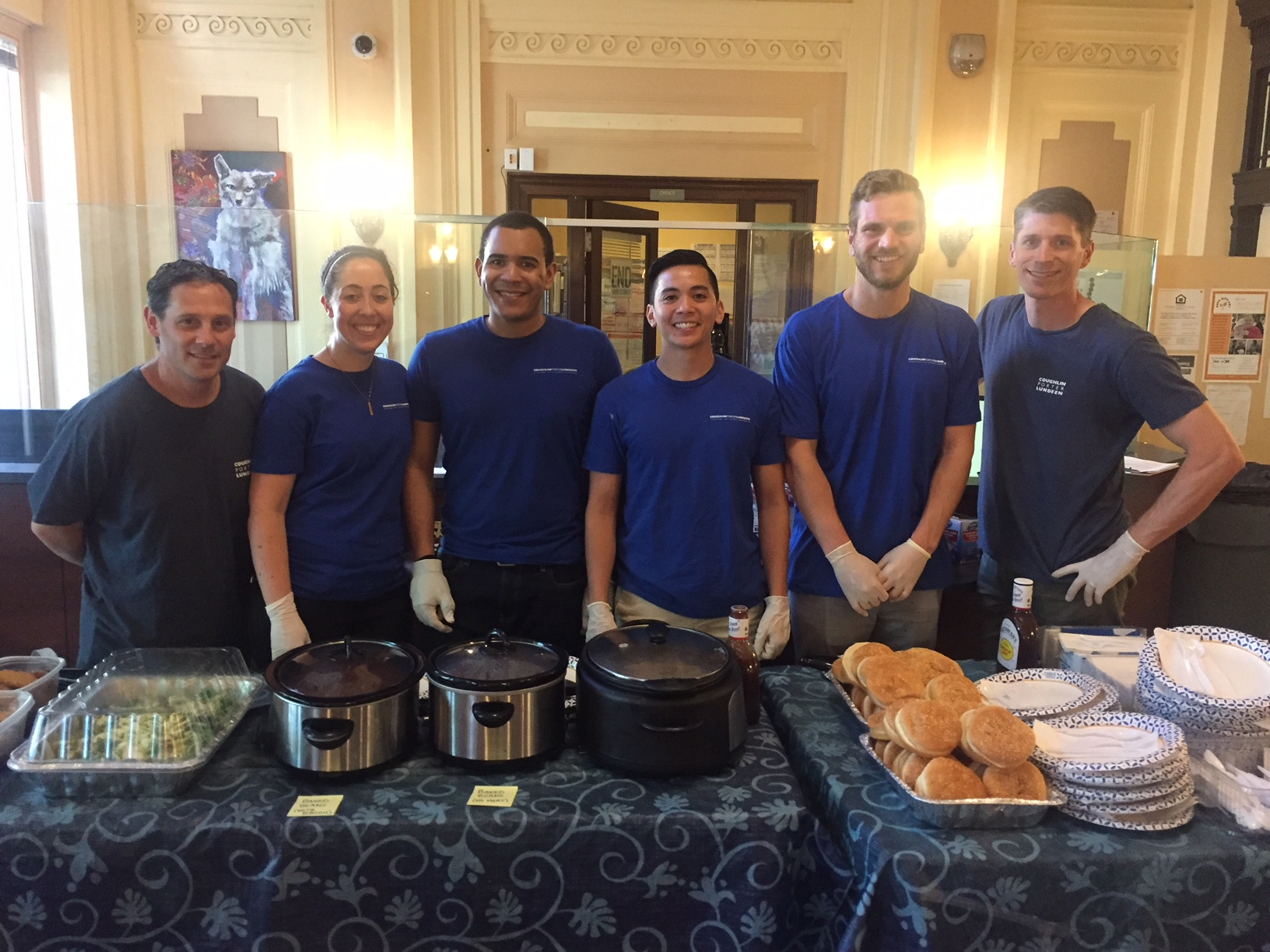 Coughlin Porter Lundeen engineers Colin, Garo, Cory, Marsha, Albert and Javier serve a meal to Plymouth House residents.