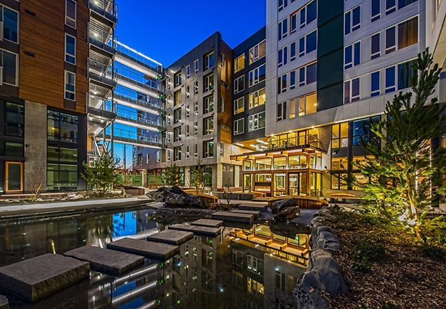 """Covering an entire block adjacent to Cascade Park, sits Sitka – one of South Lake Union's newest apartment buildings. Consisting of three 7-story cabin-like buildings with 380 units, ground level retail, and sub-grade parking, Sitka's design was inspired by the tranquility of the San Juan Islands. With a large, tree filled internal courtyard, a floating lookout called """"the tree house,"""" interconnecting bridges, and numerous green rooftop decks with urban agriculture, Sitka is truly """"An Oasis in the City."""" @sitka_seattle . . . @runbergarchitecture @vulcanrealestate @bergerpartnership @ecotopestudios @rushingcompany #exxelpacific . . 📸: Courtesy of Exxel Pacific, taken by Michael Walmsley Photography, LLC"""