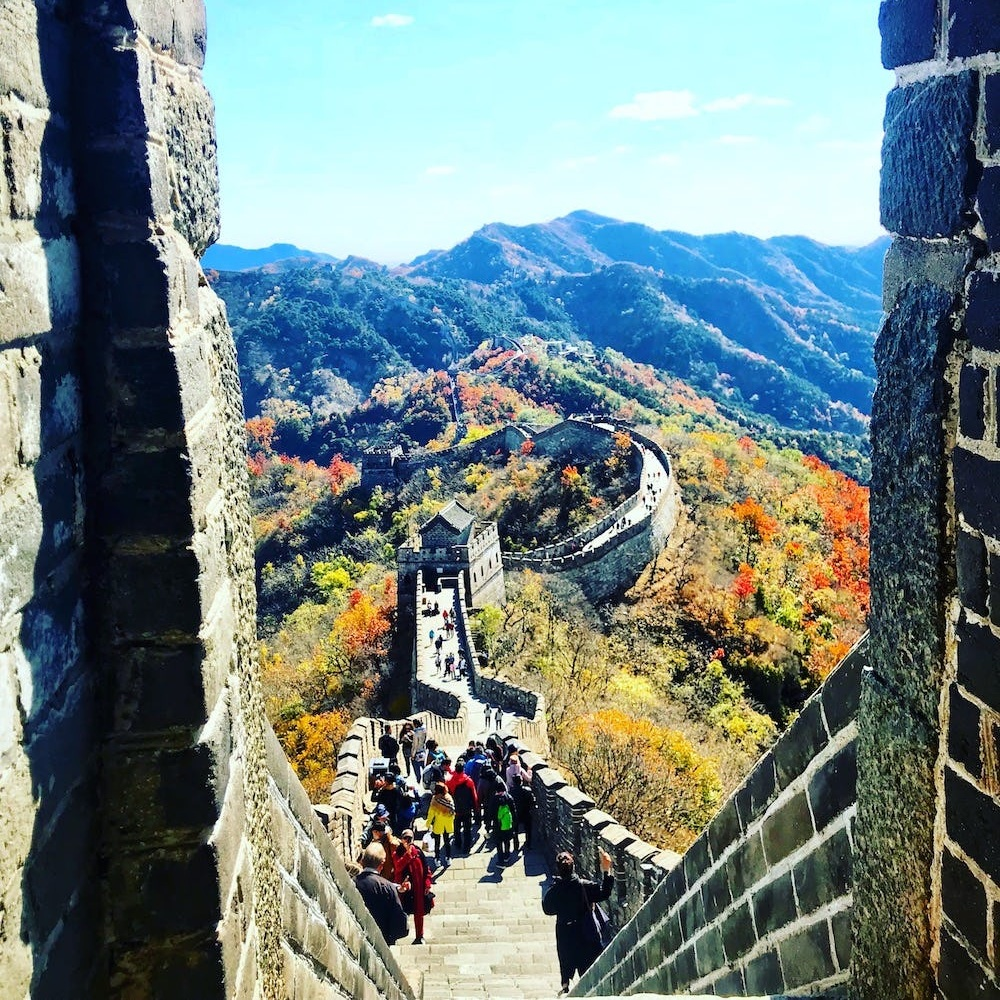 How I Discovered a New Perspective Along the Great Wall of China - BRIT + CO: The sky was a vibrant blue when I awoke in Beijing. It was the last day of my trip and, though I was still experiencing jetlag from my flight from New York City a week earlier, I awoke even earlier than usual. Too excited to sleep, I watched the sun rise over the Wangjing Soho, a Zaha Hadid building outside the window of my hotel room in the Chinese capital.(4 April 2019)