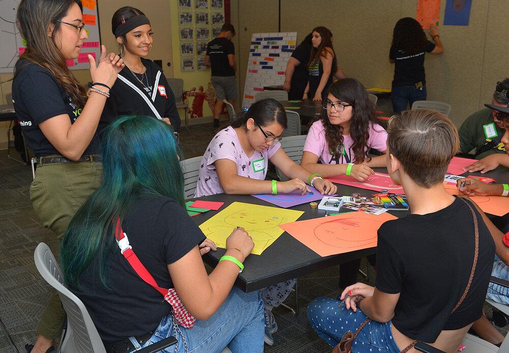 Didi Hirsch Teen Summit - Teens drawing faces