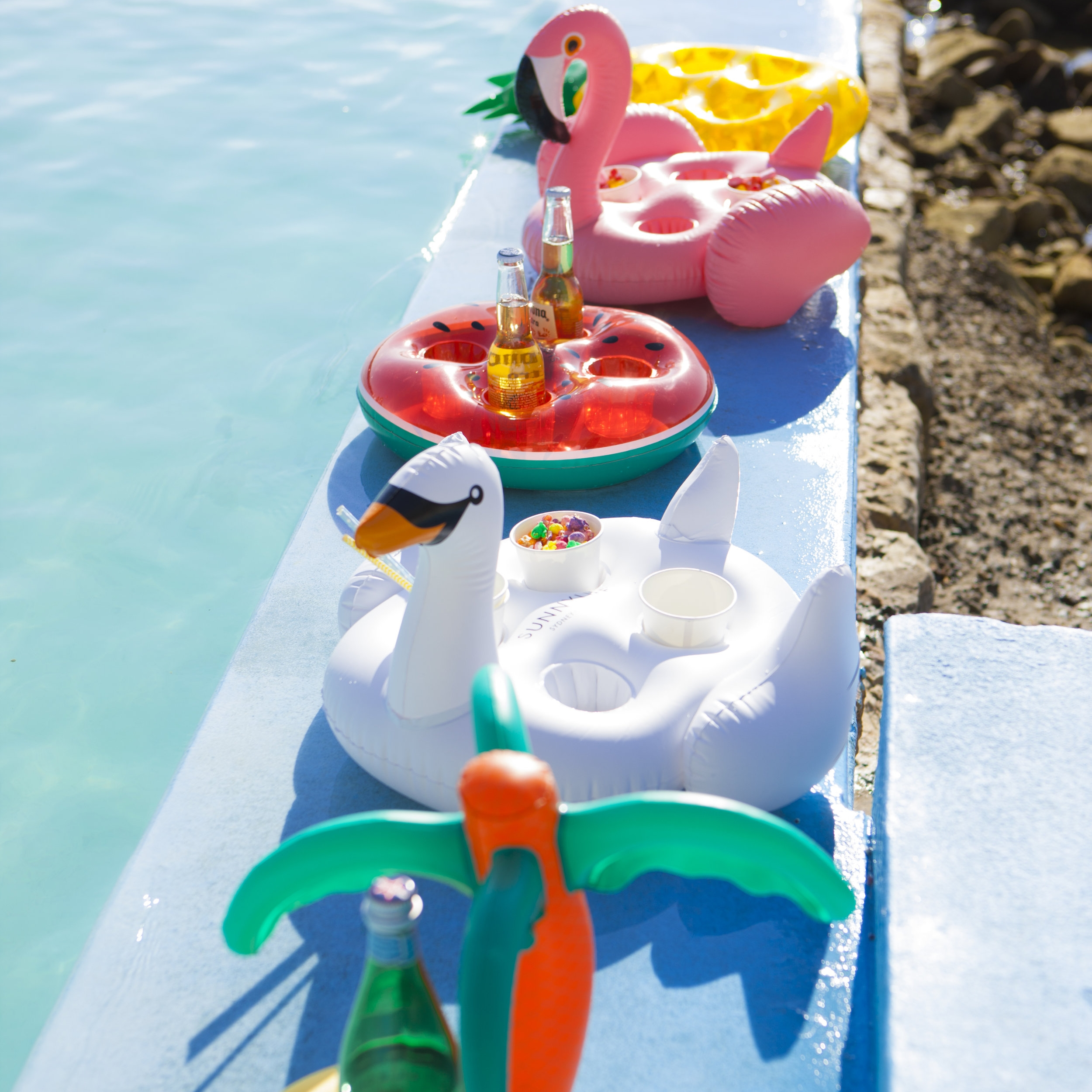 Inflatable Floating Drink Holders   Keep your beverage of choice as cool as you on a sunny day with a matching inflatable floating drink holder.