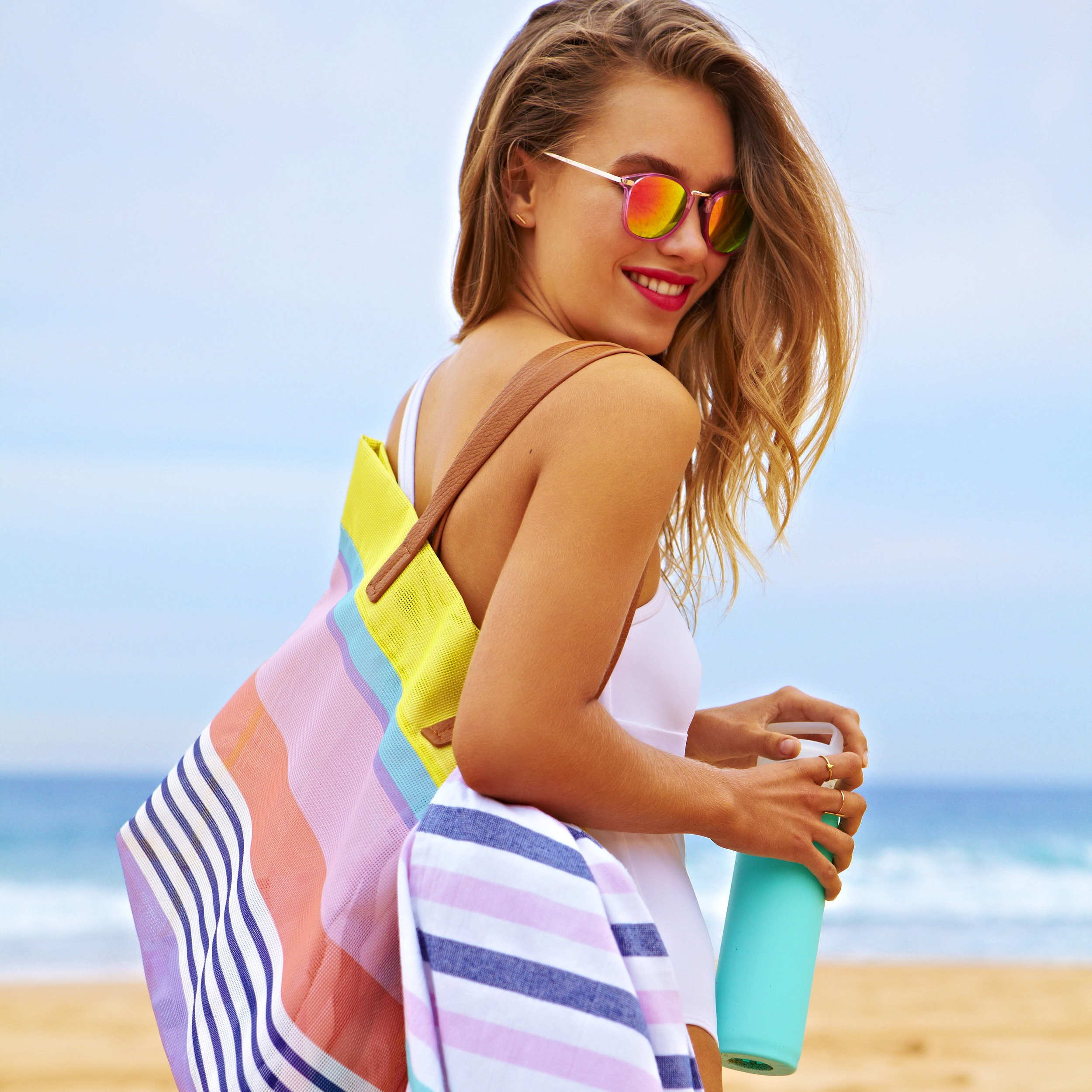 Colorful Totes and Towels   Because you need something to carry that rosé and something to sit on while sipping it, right?