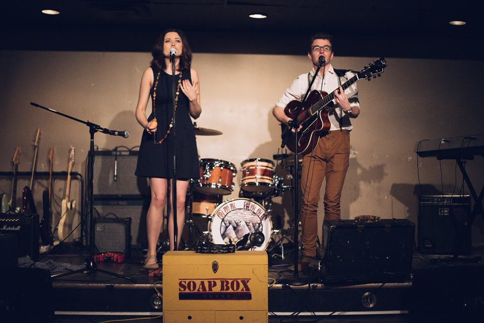 "SOAP BOX DUO - Coming onto the scene early fall of 2015, this prolific pair saturated the Edmonton and area music scene playing more than 200 live performances to date! Alexander and Jenesa MacMullin are a Canadian pop duo with a folk undertone, hinting of both rock and jazz. This powerhouse vocalist and innovative guitarist met at jazz school in Edmonton, Alberta, Canada. Their unique sound is influenced by the music of The Civil Wars, John Mayer, Aretha Franklin and Gungor, to name a few. Their passion is to use music as their 'soap box' to encourage and inspire others toward justice. The couple writes and performs about topics that stir their hearts, from personal experiences to being an empathetic voice for the burdened. These two create catchy melodies and unique instrumentation as a foundation for their lyrics; lyrics that they hope will be both heard and felt by their listeners.Since January 2016, the couple has released a music video, recorded & released their first EP, appeared on Shaw Television and were featured on multiple radio stations including CBC Radio 1. In fall the couple was nominated for the GMA's 38th Covenant Award for ""New Artist of the Year"" for 2016. Their track, ""Kissed the Girls"" was a finalist in the Los Angeles Top Vocalist competition and the New York John Lennon Songwriting Contest. The two took to the road in March 2017 on their first Western Canadian Tour and, most recently, the duo's song ""Complexion"" has been nominated for the Edmonton Music Award for the ""Adult Alternative Recording of the Year"" for 2016. Just last month the dynamic couple attended an intimate songwriters retreat with Judy Stakee, formerly of Warner Chappell in LA, where they ventured to further hone their craft as musical storytellers."