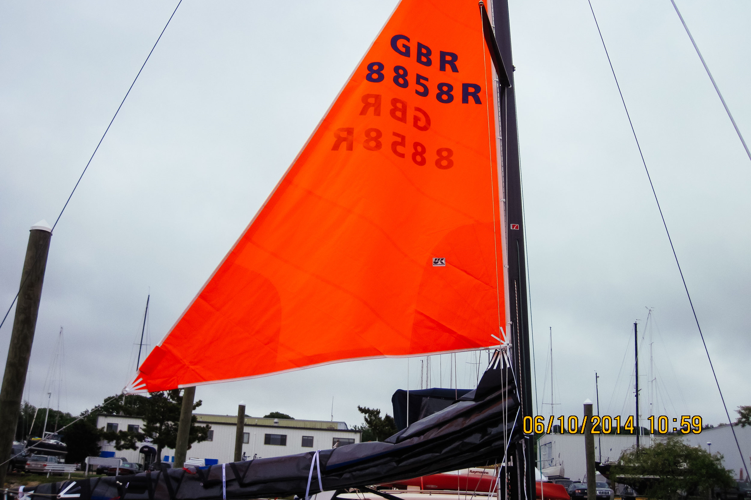 """The """"droopy clew"""" of the trysail allows the tack to be raised above the stack of mainsail luff cars when the sail is left on the boom."""