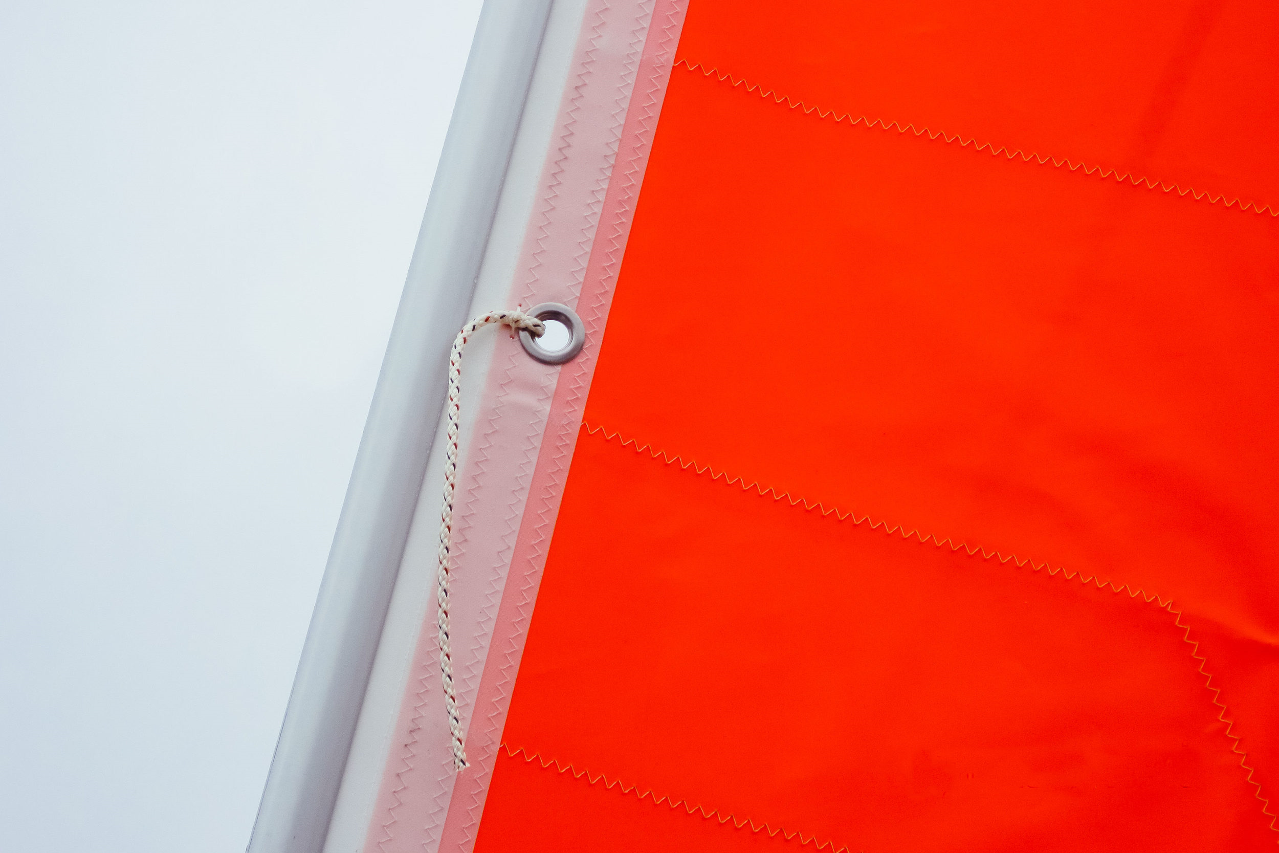 The most common alternate luff attachment is to tie around the headstay. The ties have to be permanently attached to the sail.