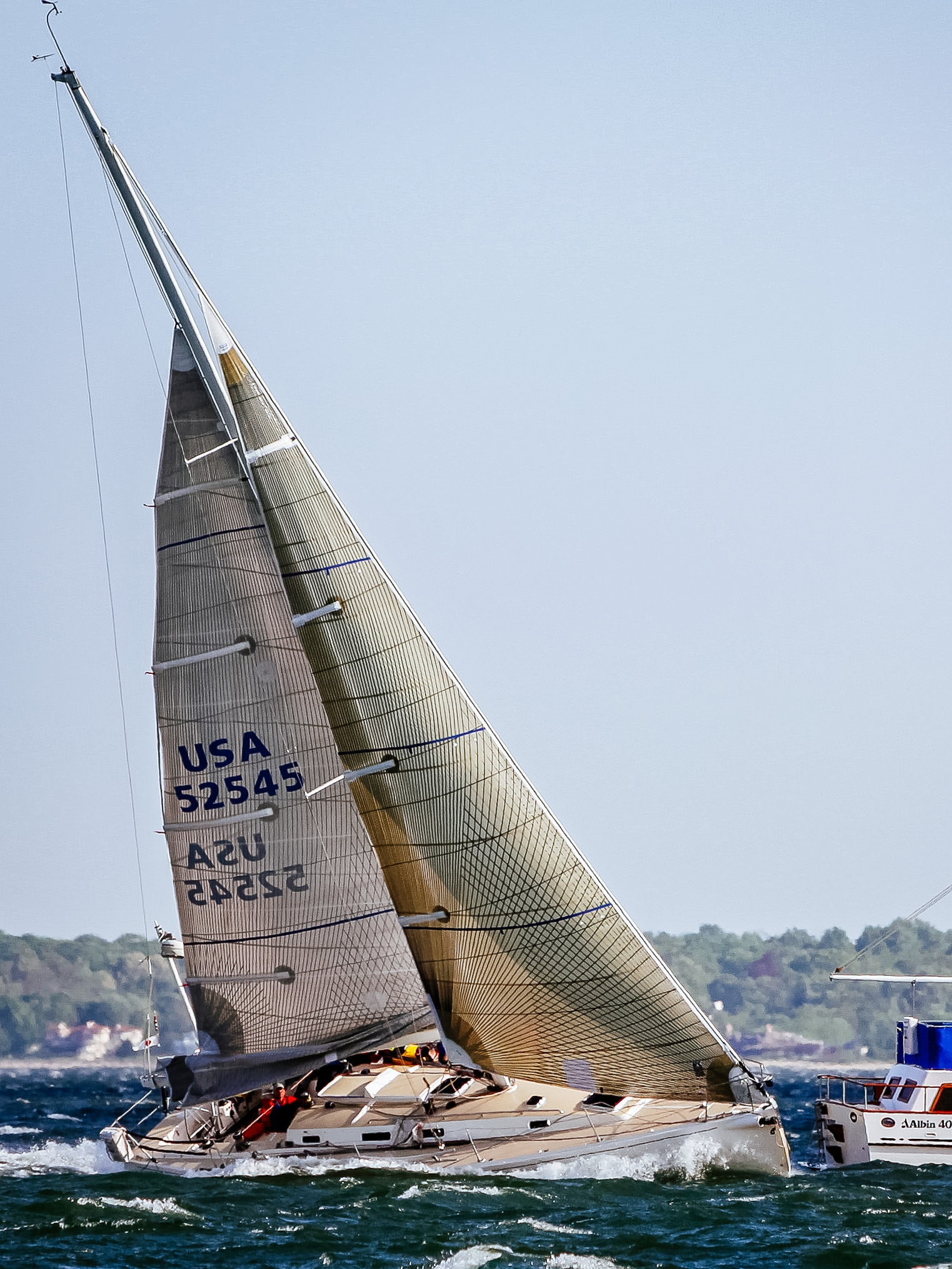 A J/133 finishing a race in 40 knots with a Tape-Drive Carbon/Aramid No. 4 and two reefs.