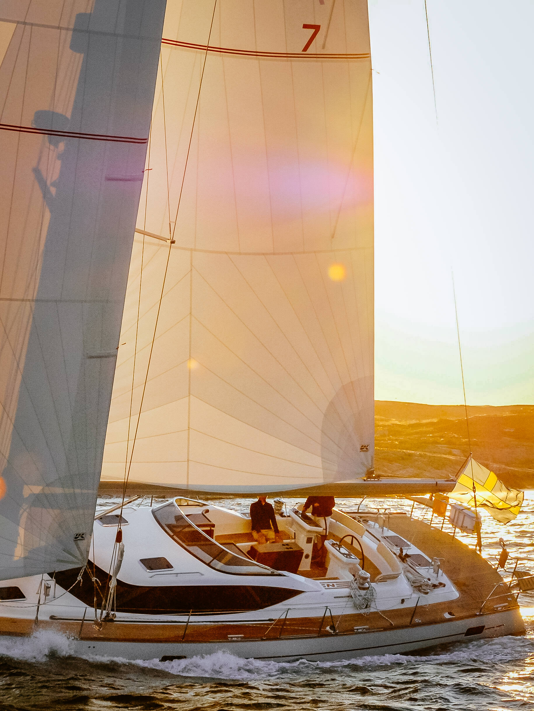 A Najad 570 with a tri-radial Spectra roller-furling performance cruising mainsail in the partially reefed position.