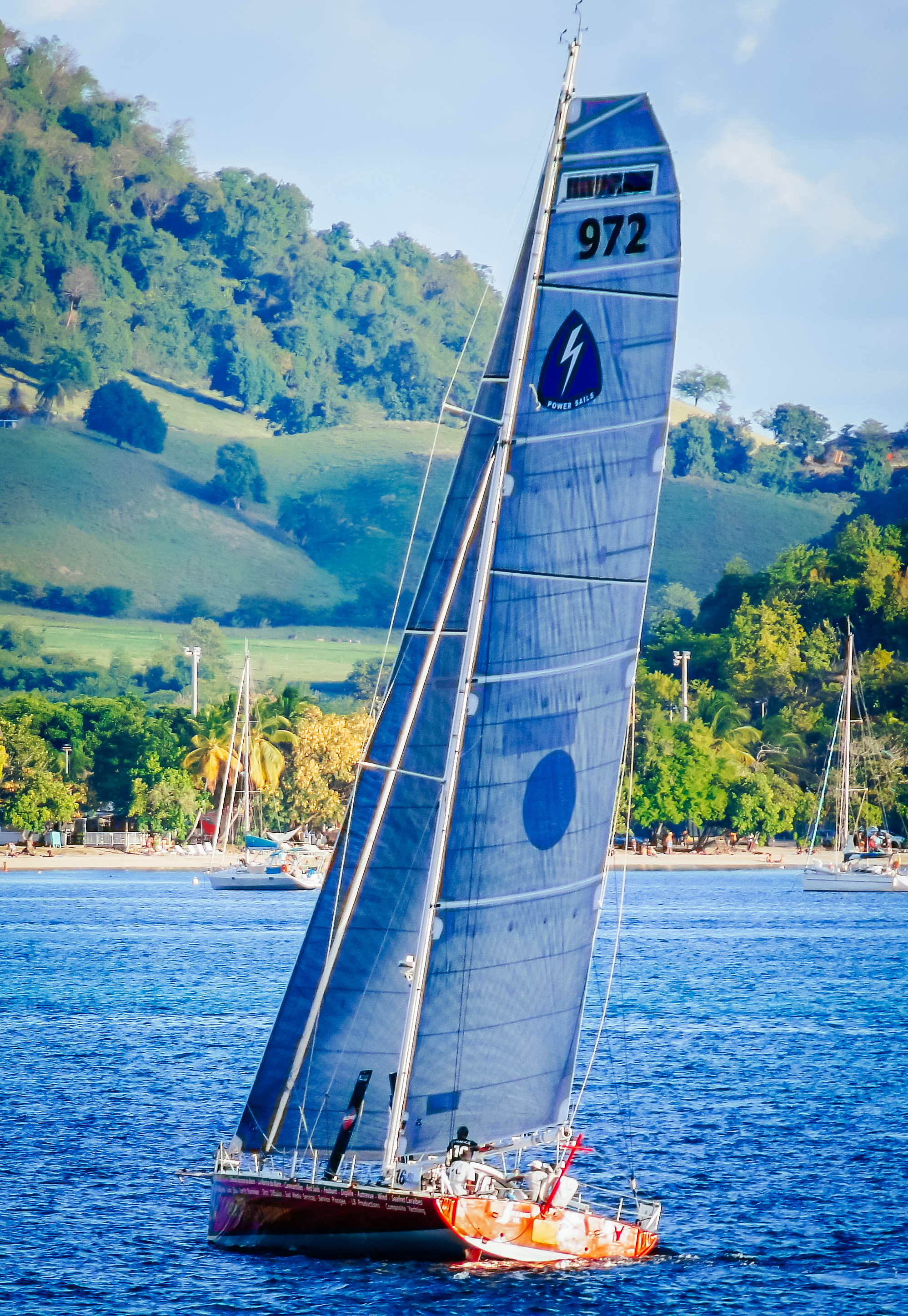 An Open 50 with offshore racing Titanium sails that have double-sided taffeta.