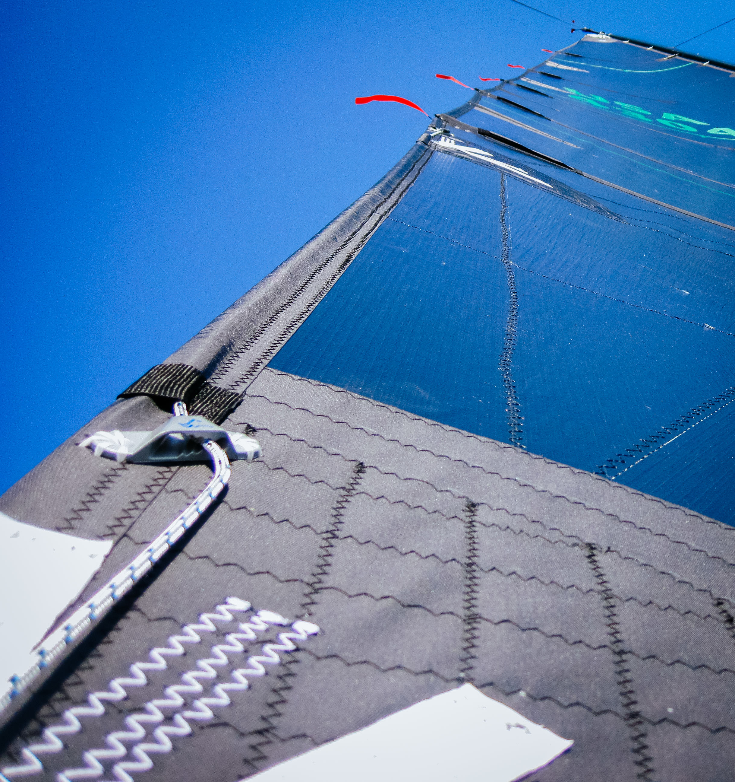 The standard location for a leech line cleat is just above the clew of a mainsail