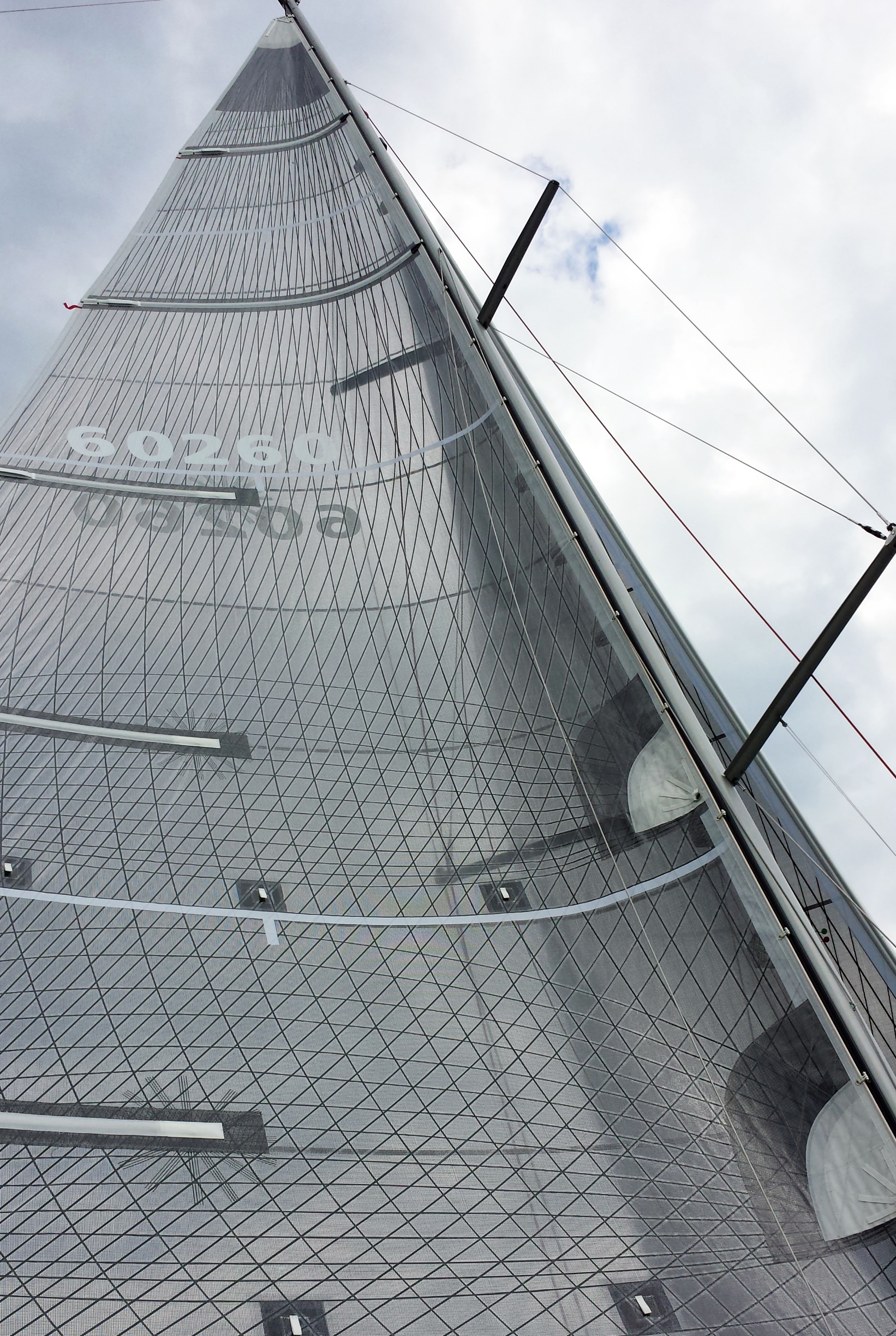 For sails with extra roach up high or lower aspect mainsails, UK Sailmakers offers the Powerhead with the two full-length battens. Shown above is a Tape-Drive Carbon Technora main with the top two battens being full length.