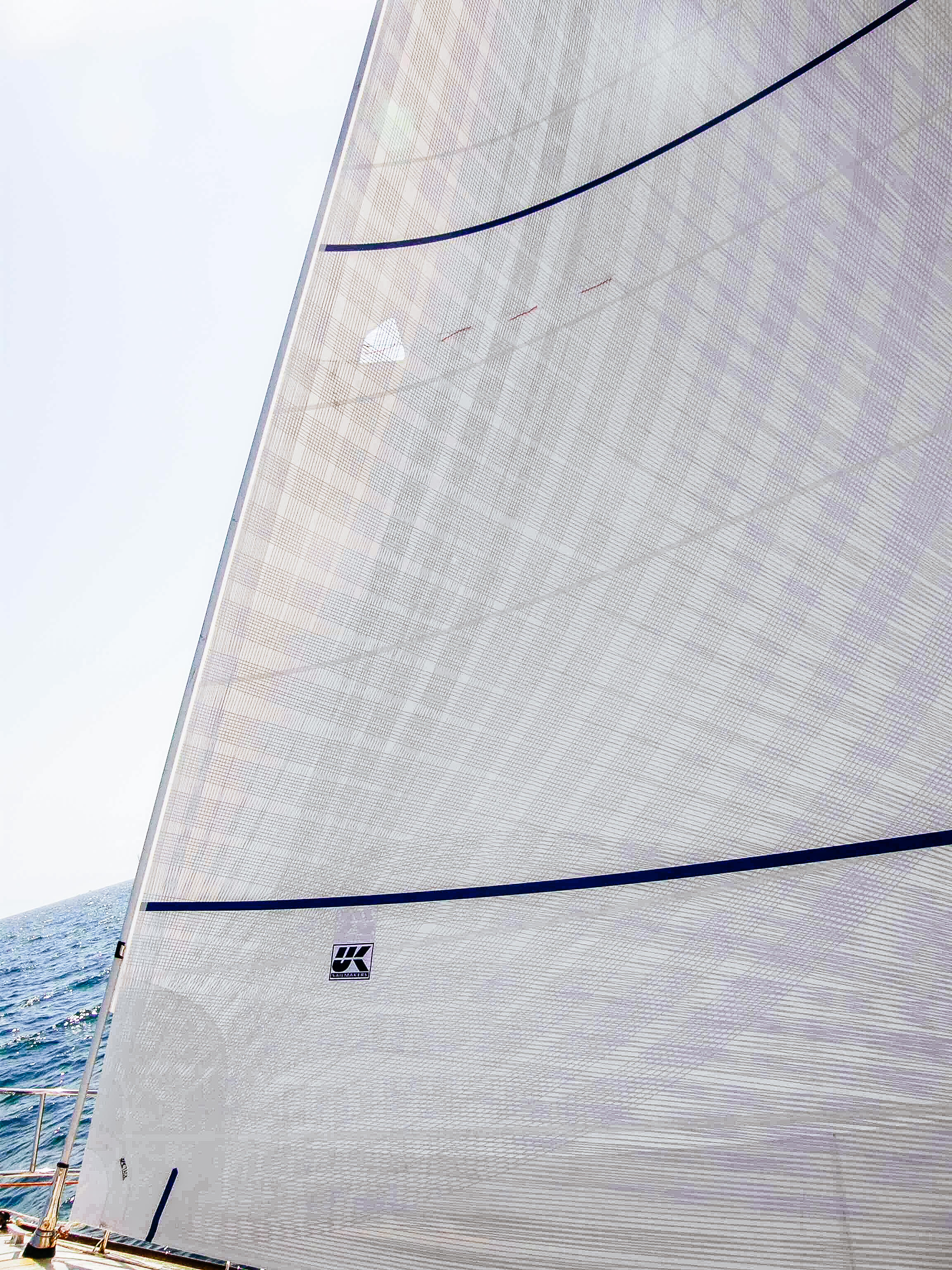A Davidson 52 X-Drive Carbon/Spectra genoa with a layer of taffeta applied over the tapes. The second side of the sail material came from Dimension Polyant with a taffeta side.