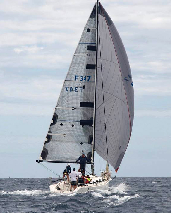 The Beneteau First 34.7 CIRCA running in heavy air with an A3