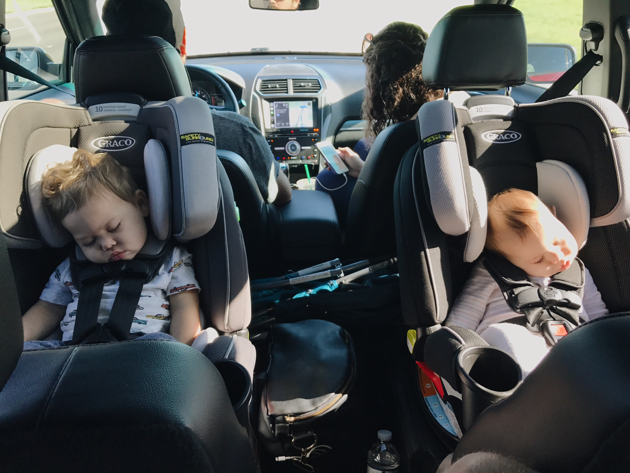 We didn't even make it to the airport and the babes were passed out!