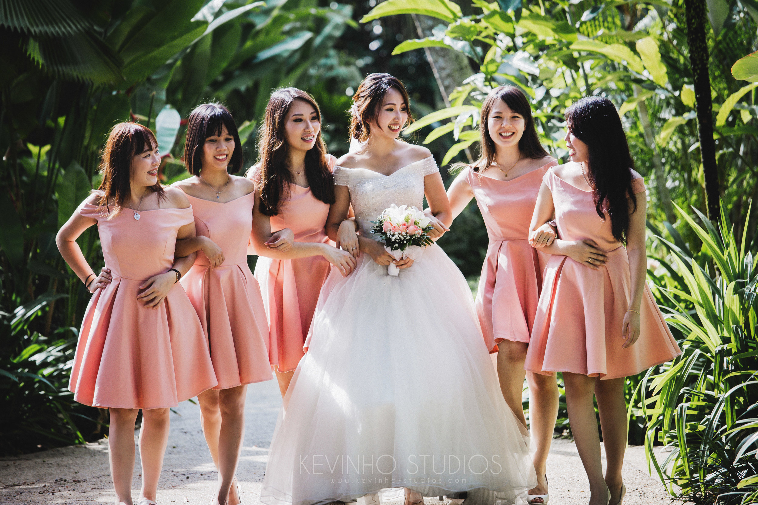 The bride, surrounded by her bridemaids on her actual day.   Photo credits:  Kevin Ho Studios.