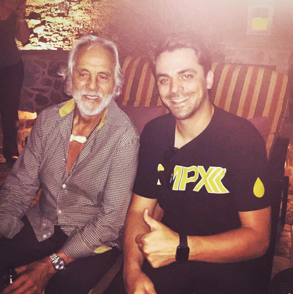 Employee of the Month Calvin Garcia pictured with Tommy Chong