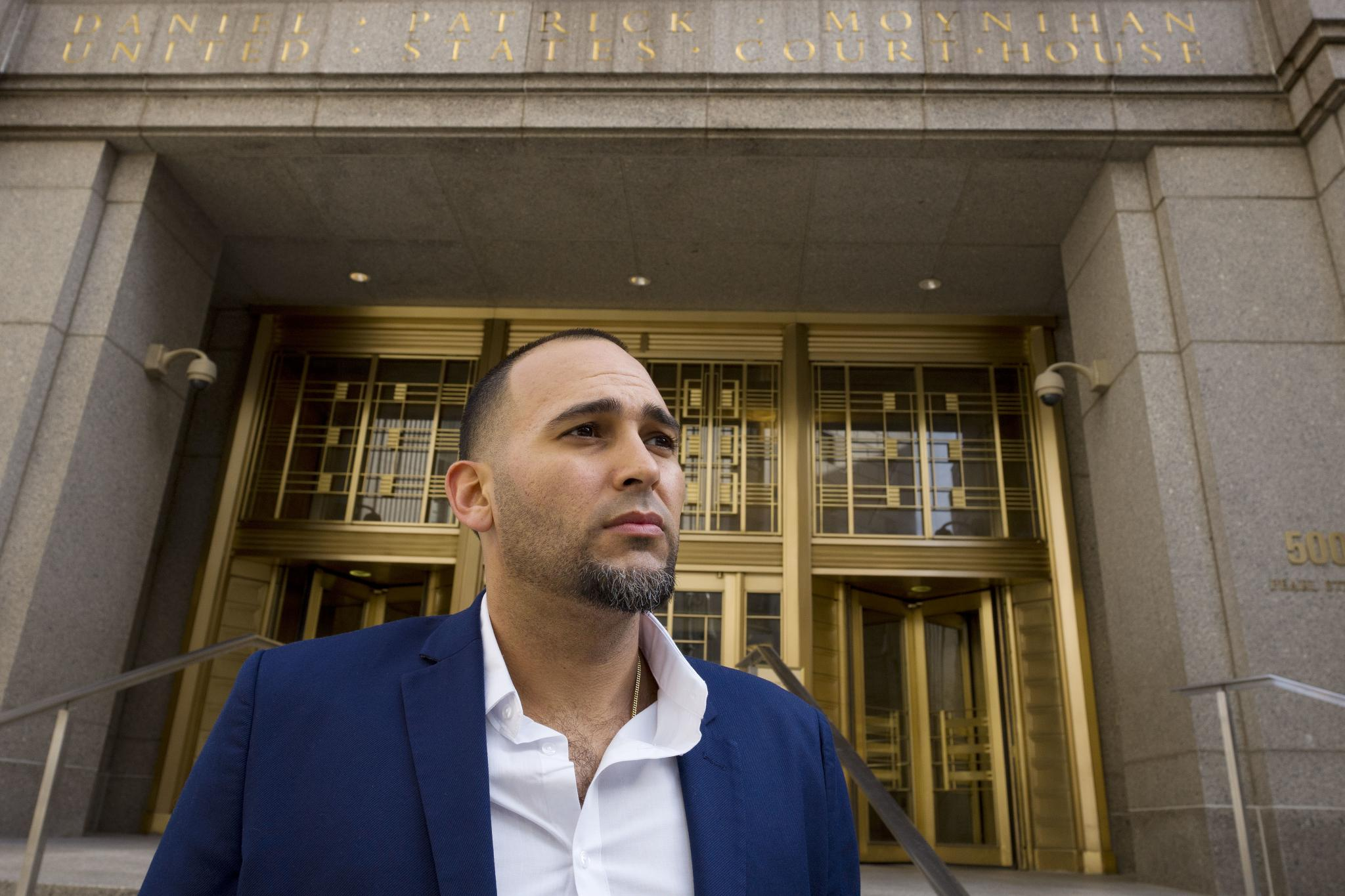 Iraq war veteran Jose Belen, who takes marijuana to treat post-traumatic stress disorder, poses in front of federal court on Tuesday, Feb. 13, 2018, in New York.(Credit: AP Photo/Mark Lennihan)