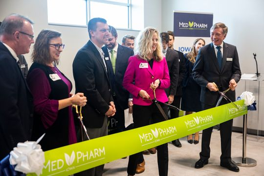 Advocates, lawmakers and people involved in the opening of Iowa's first  medical-marijuana production facility, MedPharm, cut the ribbon during  an open house on Thursday, Nov. 1, 2018, in Des Moines.  (Photo: Kelsey Kremer/The Register)