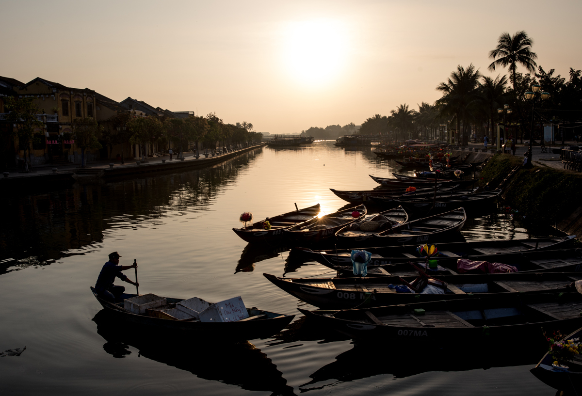Tourist boats docked along the river in the ancient town of Hoi An, Vietnam at sunrise. In 1999 Hoi An was recognized as a UNESCO World Heritage site. Photo by Justin Mott for The New York Times