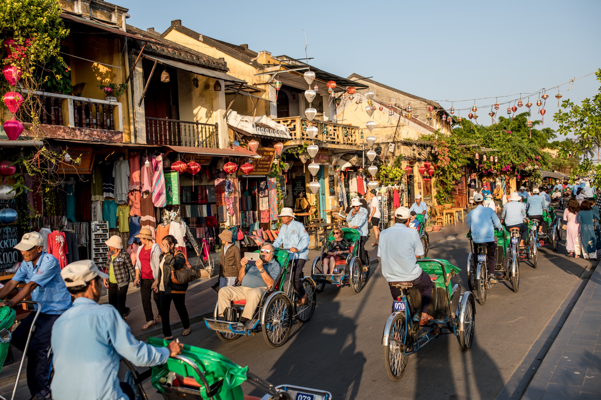 Cyclo tours through the ancient town of Hoi An, Vietnam are a popular tourist attraction. Photo by Justin Mott for The New York Times