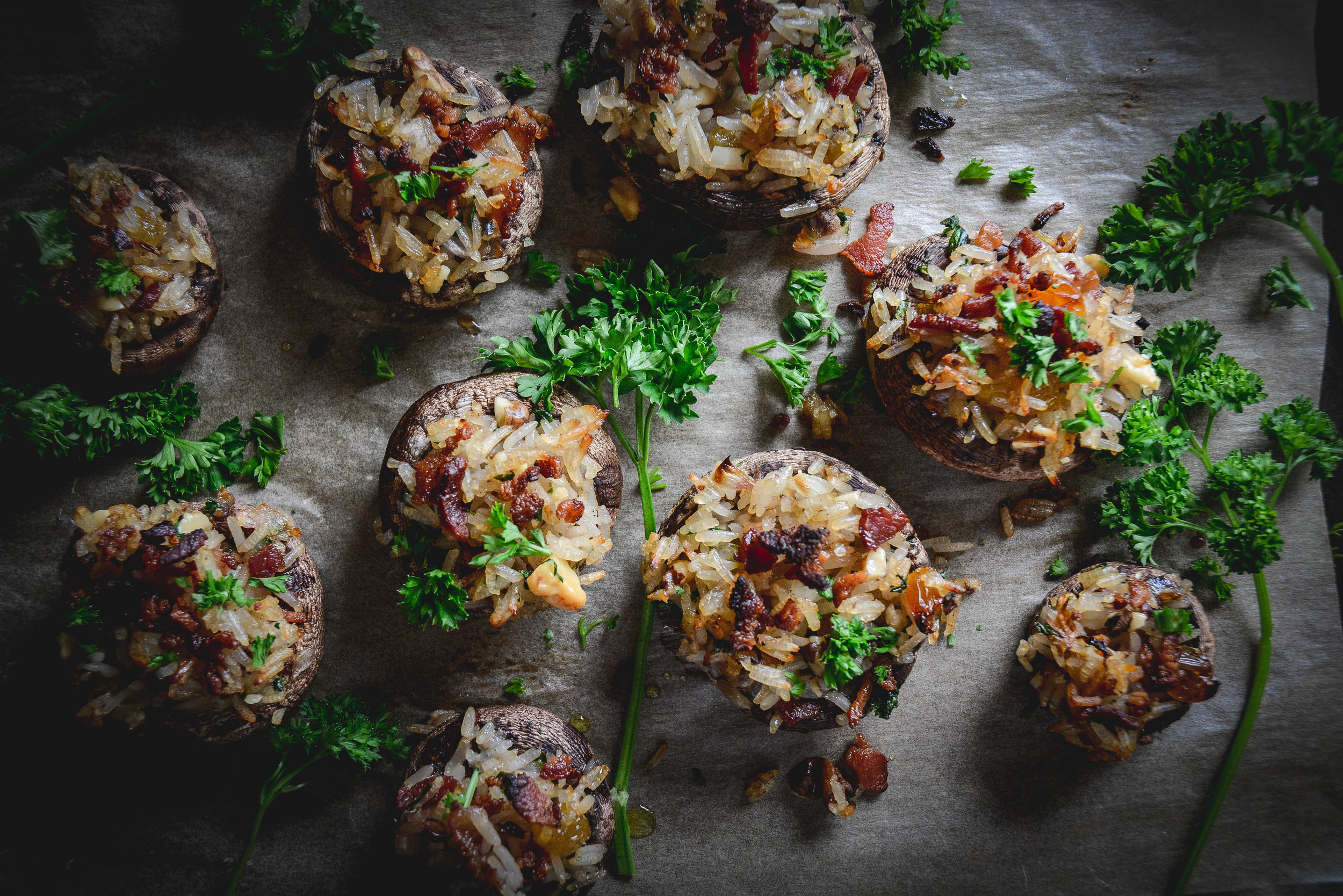 stuffed mushrooms with parsley, rice, bacon, walnuts and raisins