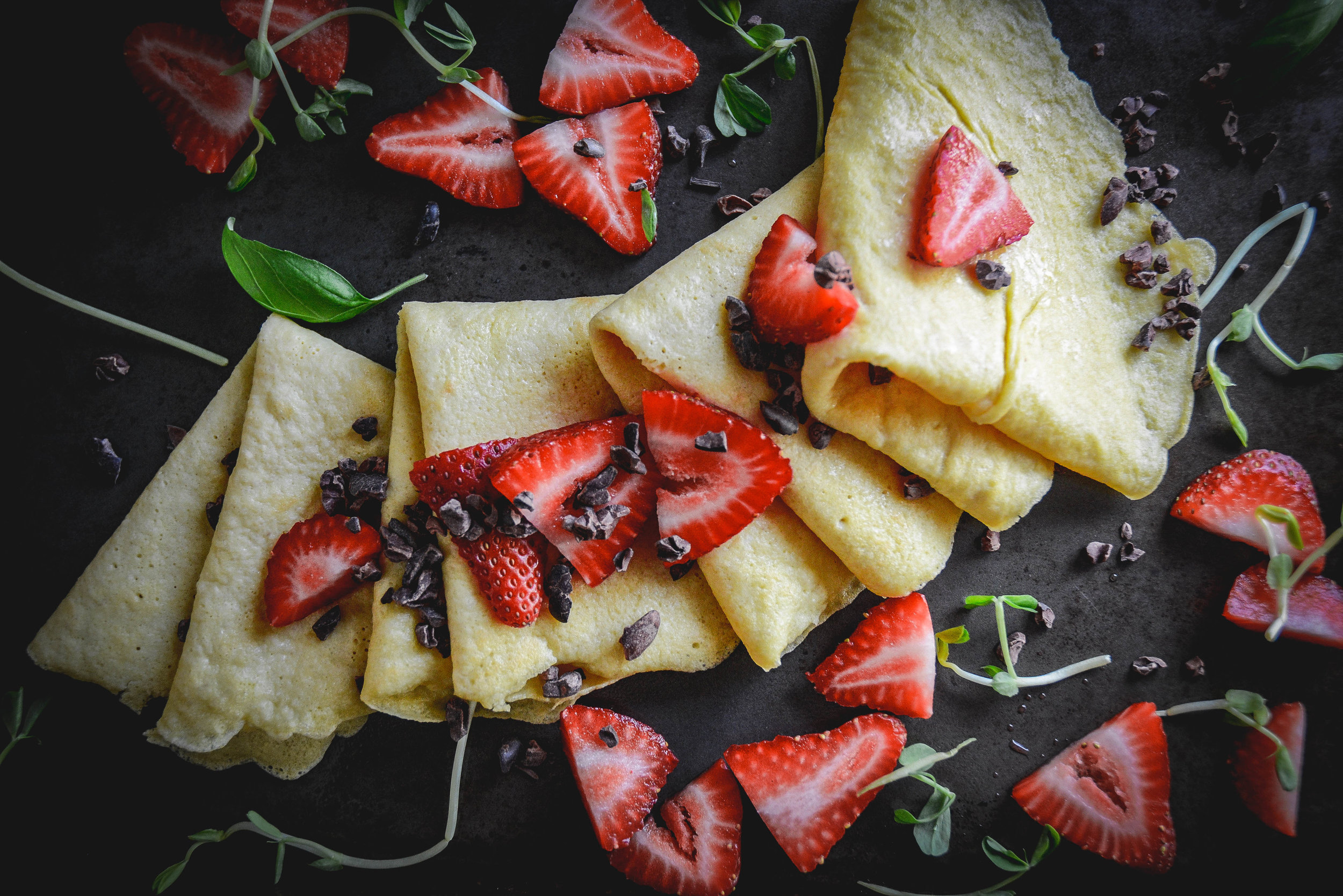 crepes, strawberries and greens