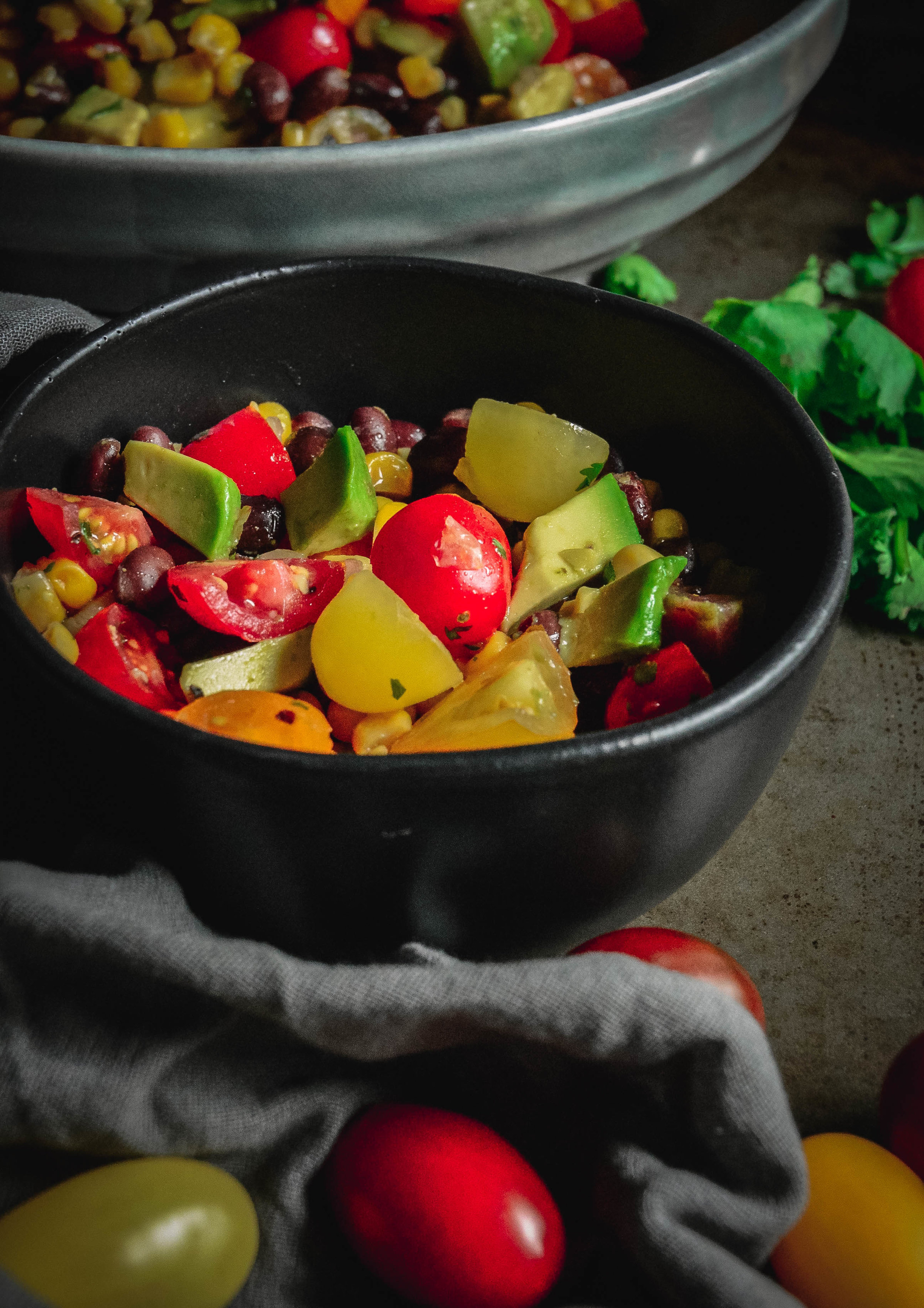 tomato salad with black beans, corn and avocado