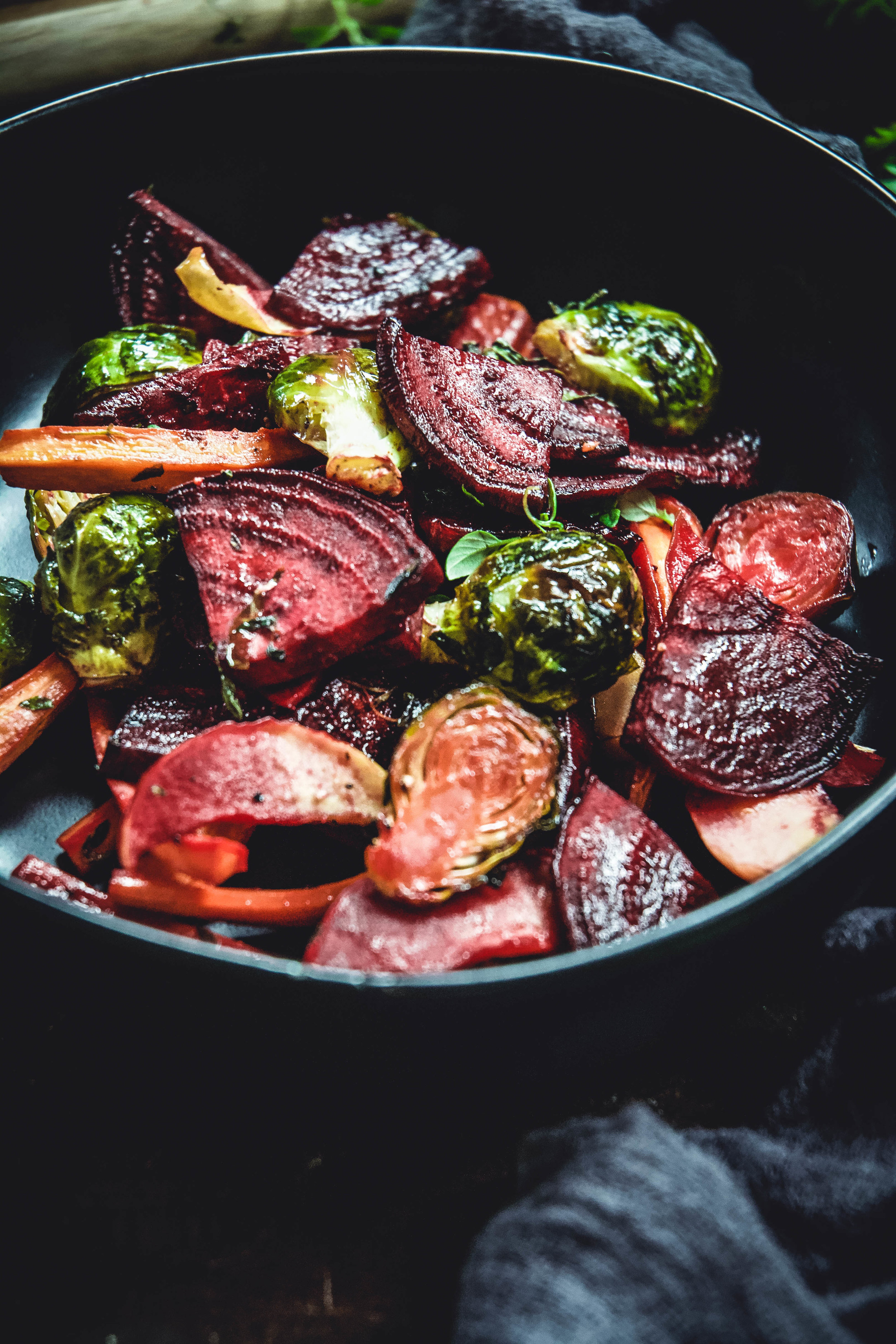 Experience all of fall's produce in one delicious side dish. Roasted beets, apple, carrots and Brussels sprouts work perfectly with maple syrup and dijon mustard to create a delicious, festive Thanksgiving, holiday or every day side dish. It's vegan, paleo with a whole 30 option as well. #vegan #calmeats #thanksgivingsides #fallsides #fallproduce #sidedishes #beets #carrots #brusselssprouts #paleosides #paleothanksgiving #whole30sides #whole30thankgiving