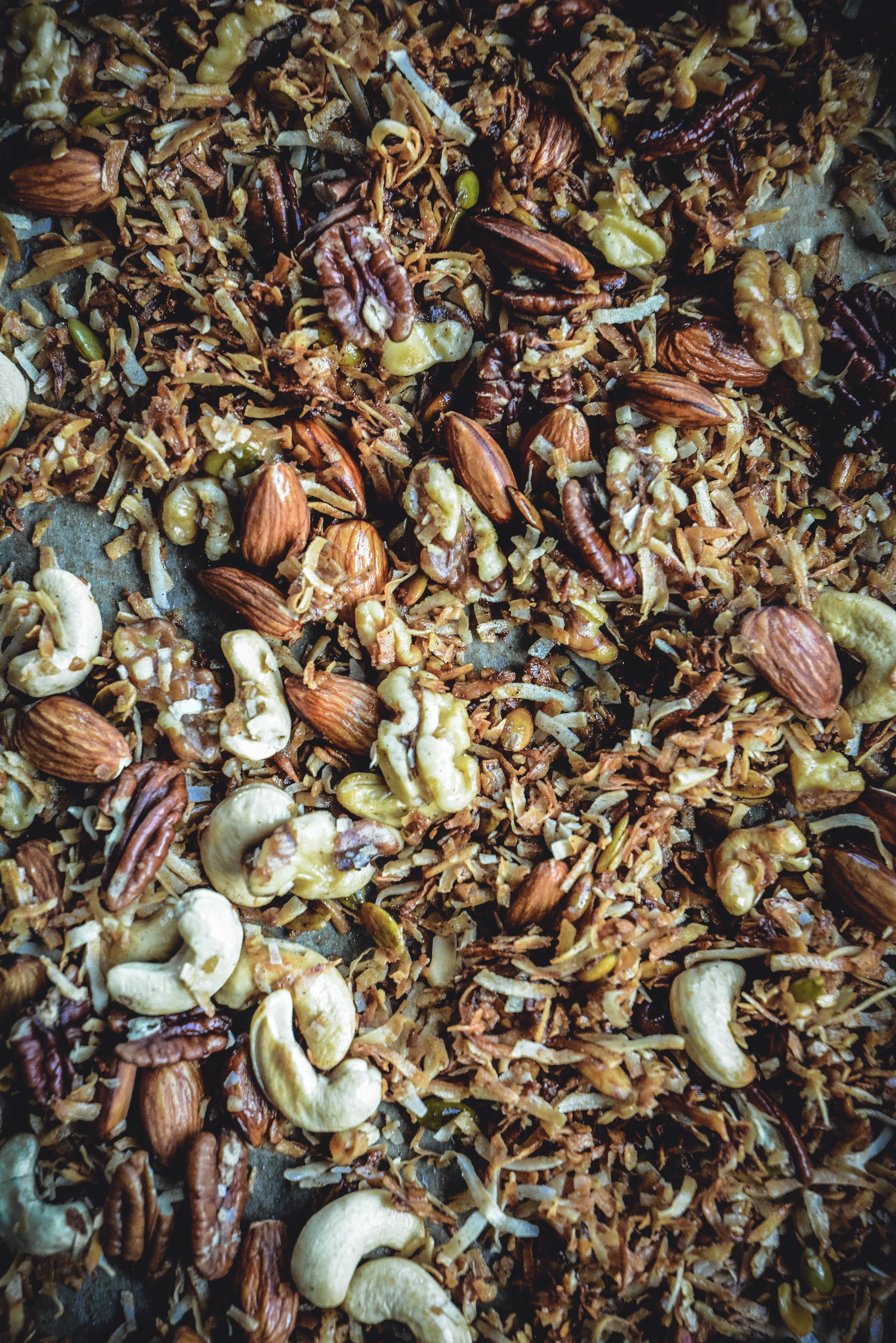 walnuts, pecans, almonds, coconut flakes, cashews, pumpkin seeds