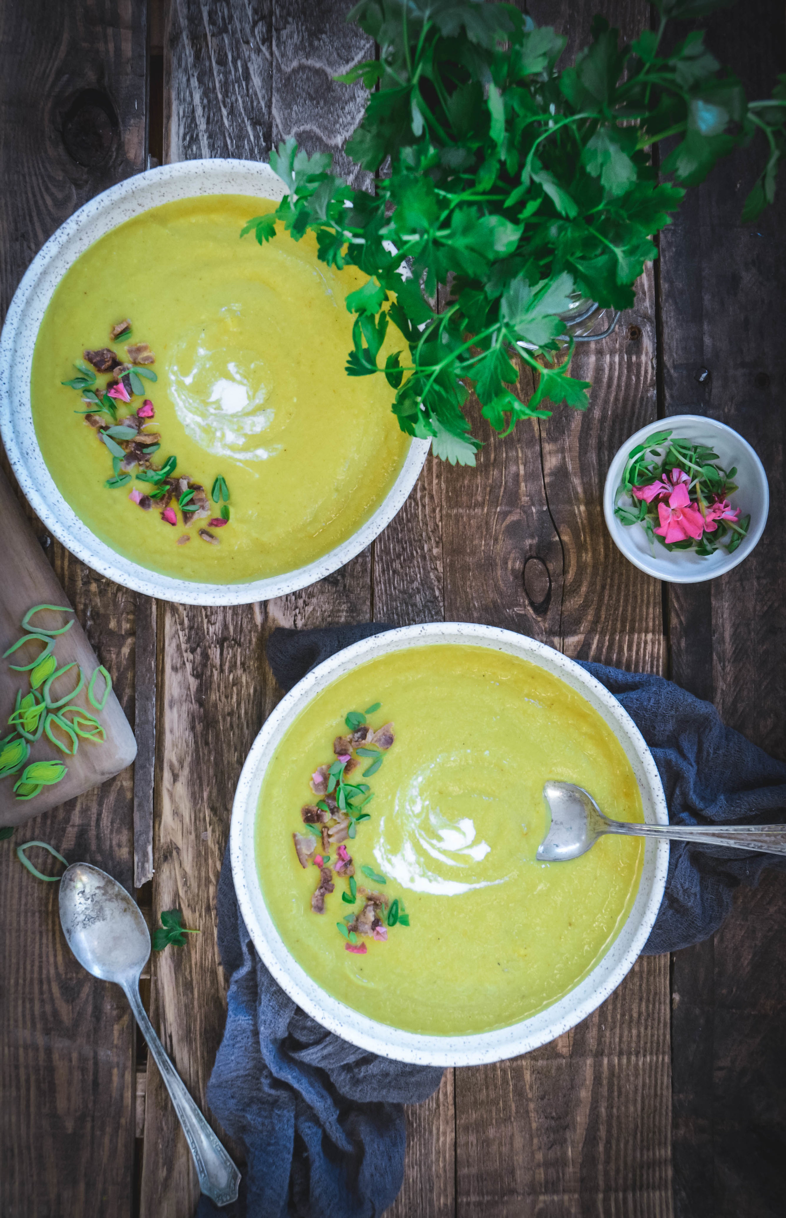 This cauliflower soup is loaded with spices and flavor. It's a creamy, velvety soup perfect anytime of year. It can easily be customized to fit a vegan lifestyle by skipping the bacon entirely. #cauliflowersoup, #whole30soup, #whole30 #paleo #vegan #turmeric #ginger #calmeats #spices #soup #lunchideas #dinnerrecipes #freshrecipes #paleorecipes #whole30recipes #glutenfree #dairyfreesoup #dairyfree