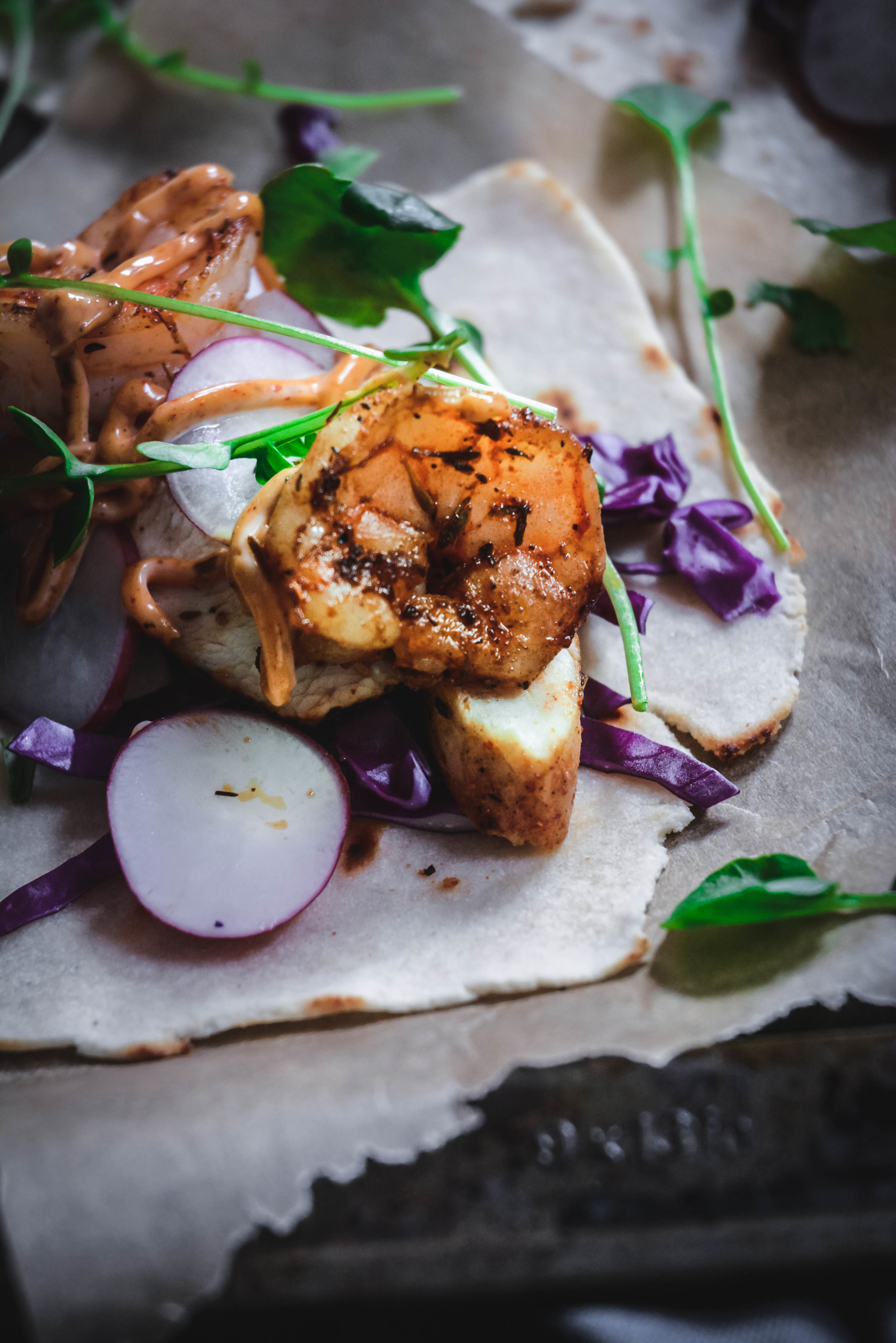 up close shot of jerk chicken and shrimp taco