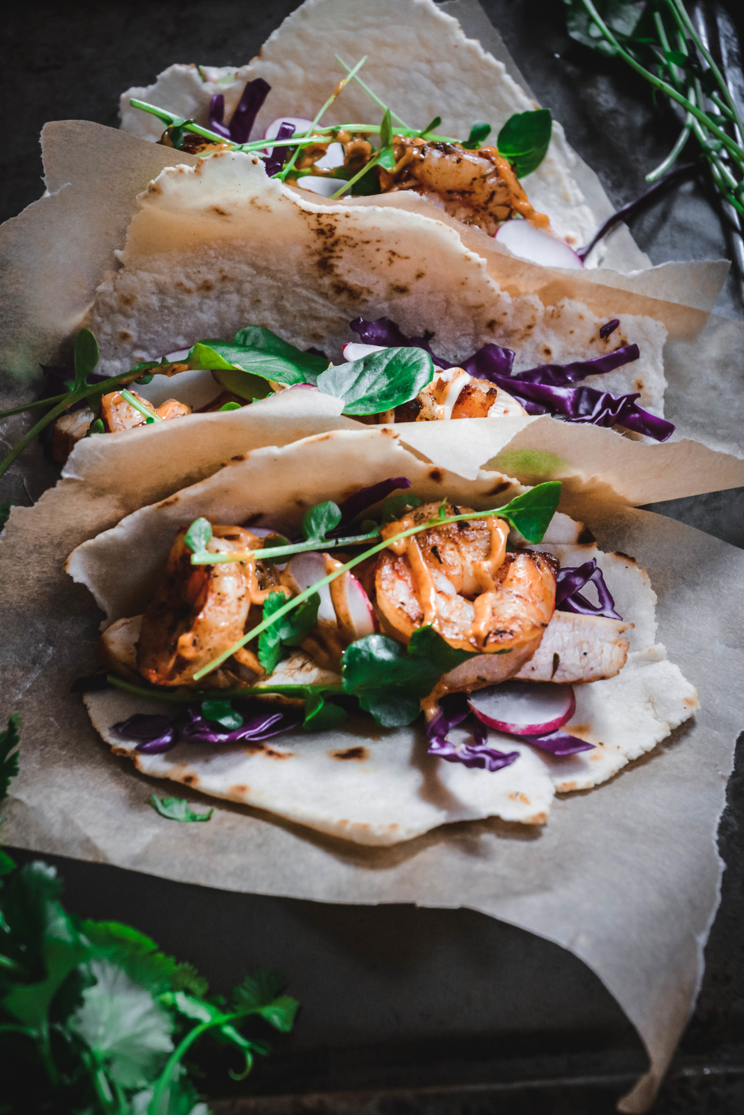 Jerk Chicken and Shrimp Tacos with Jerk mayo and greens