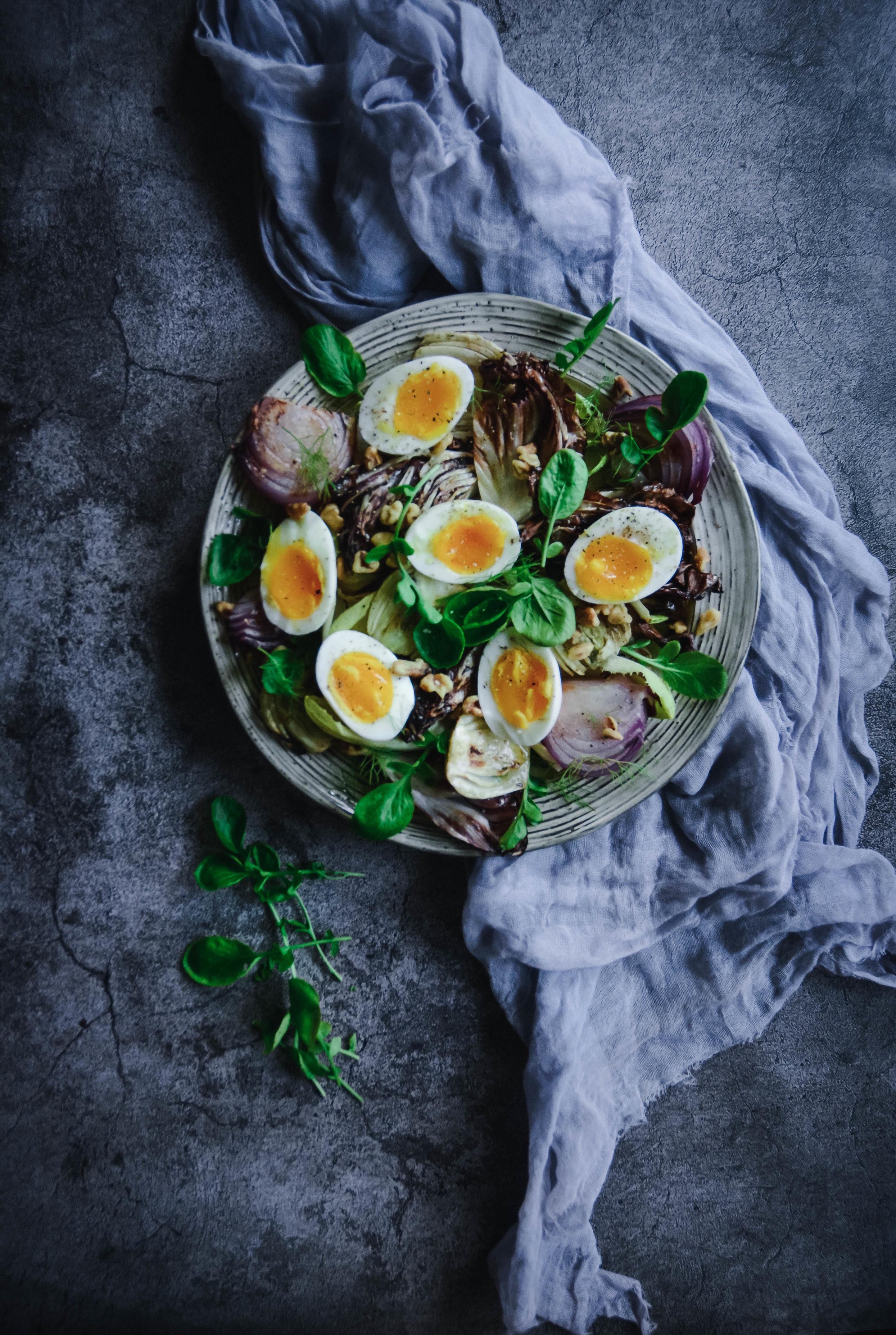 Radicchio salad with eggs on napkin on plate