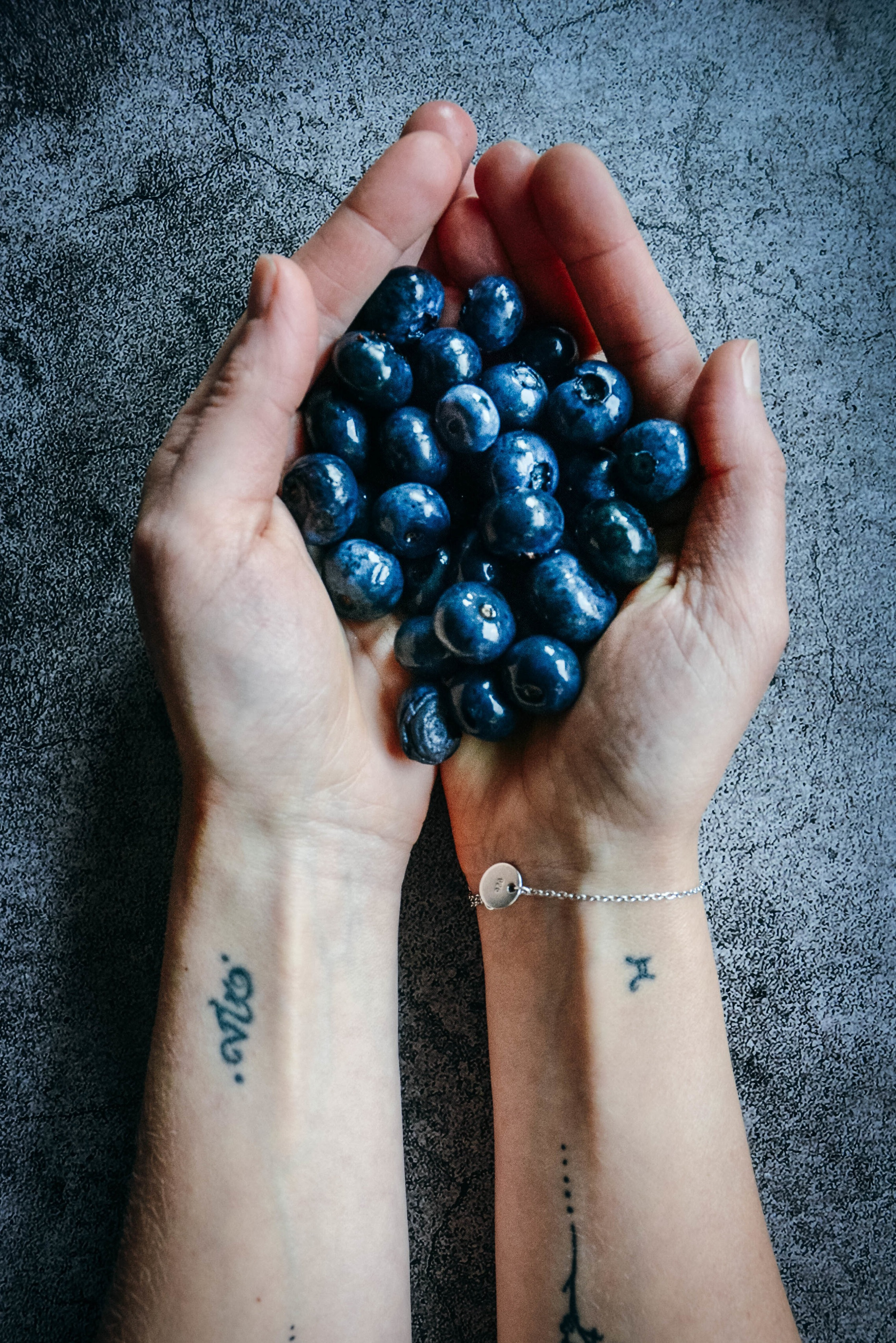 Hands and blueberries