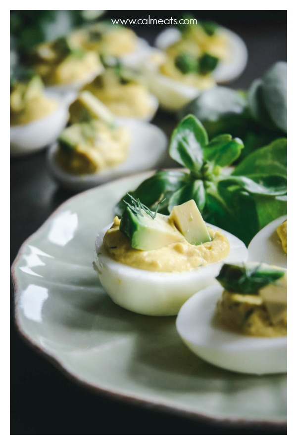 Deviled eggs are a staple appetizer for any gathering at my house. They're easy to make, are nutritious and a crowdpleaser. They're paleo, whole 30 and vegetarian too. #deviledeggs, #appetizers #whole30appetizers #paleoappetizers #calmeats #vegetarian #glutenfree #dairyfree #paleolifestyle #paleofood #eggs #eggrecipes