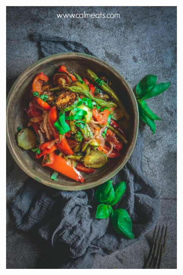 If you're looking for the prefect side for pretty much any dish, check out this simple 10 minute grilled vegetables recipe. Red onion, bell peppers, zucchini and green beans come together with extra virgin olive oil, salt, pepper, balsamic vinegar and fresh basil. This recipe is vegan, paleo and whole 30. #calmeats, #grilling, #grilledvegetables, #vegetables, #sidedishes, #vegan, #vegansides, #whole30