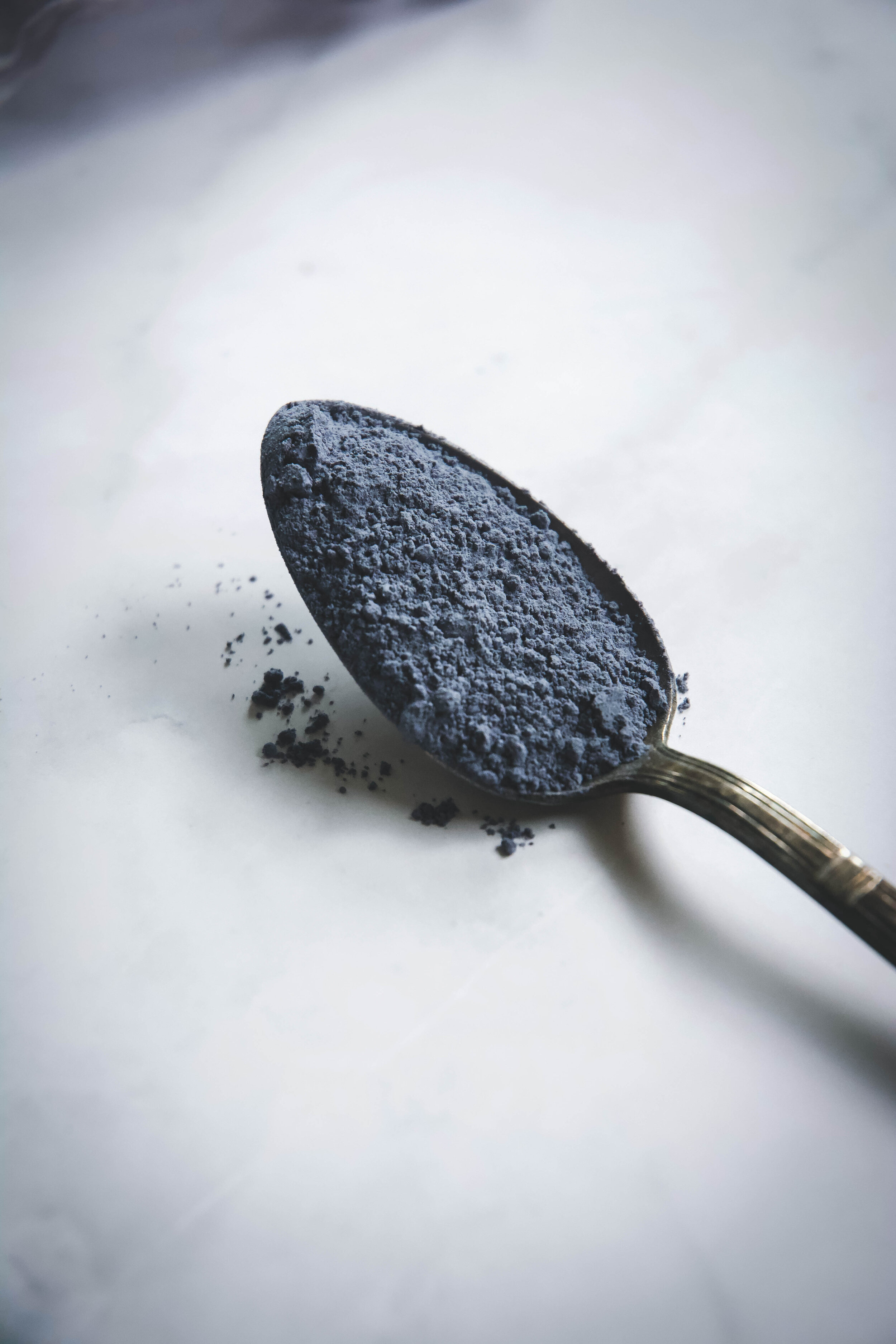 Blue powder in spoon