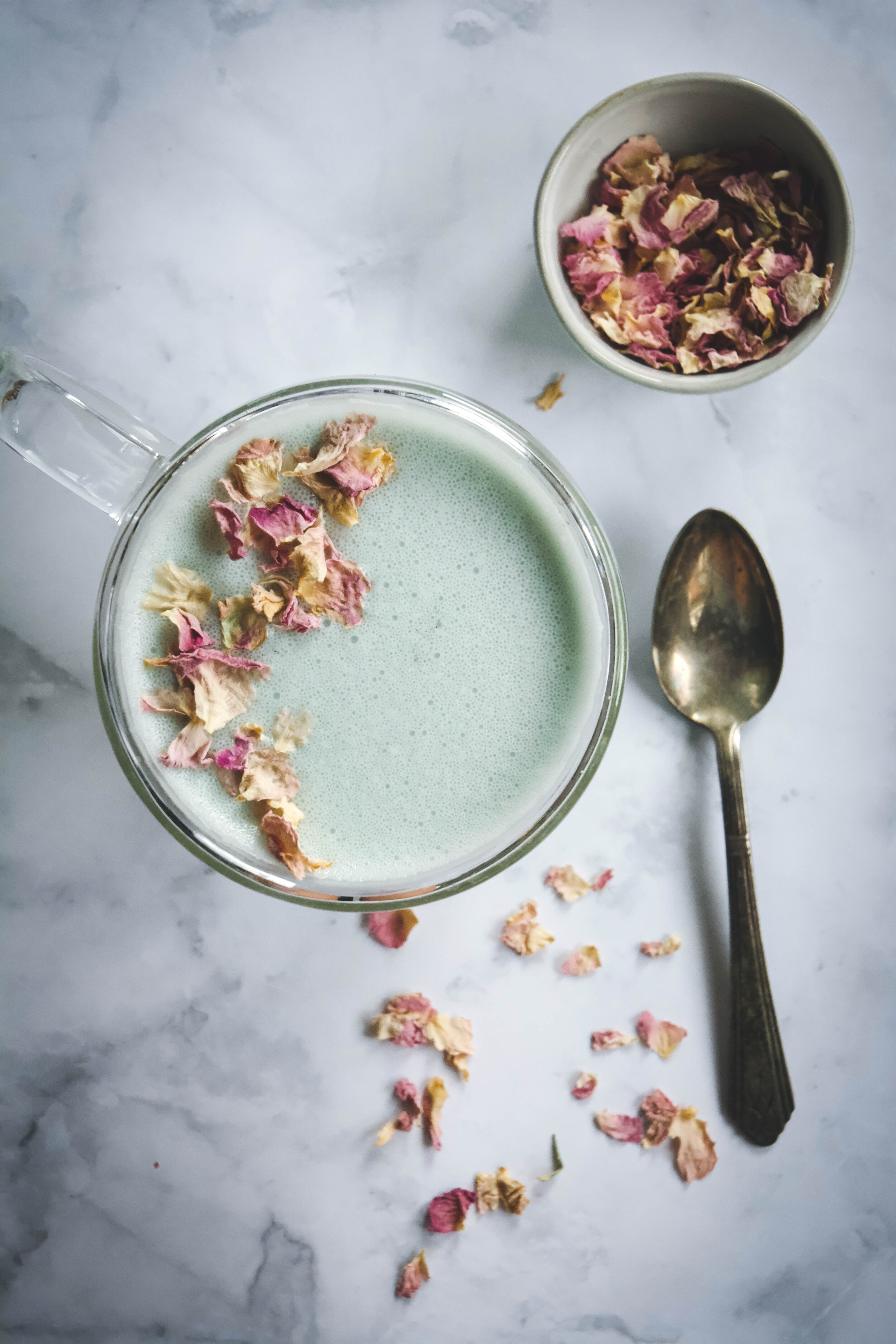 Cardamom moon milk is the ideal drink right before sleep. Cardamom, ashwaganda, gorgeous butterfly pea flower powder, coconut oil and honey make this soothing drink my favorite go to for great sleep. #moonmilk #cardamom #ashwaganda #calmeats #vegan #paleo #whole30 #hormonebalance #sleepdrink #ayurvedicmilk #cardamommoonmilk