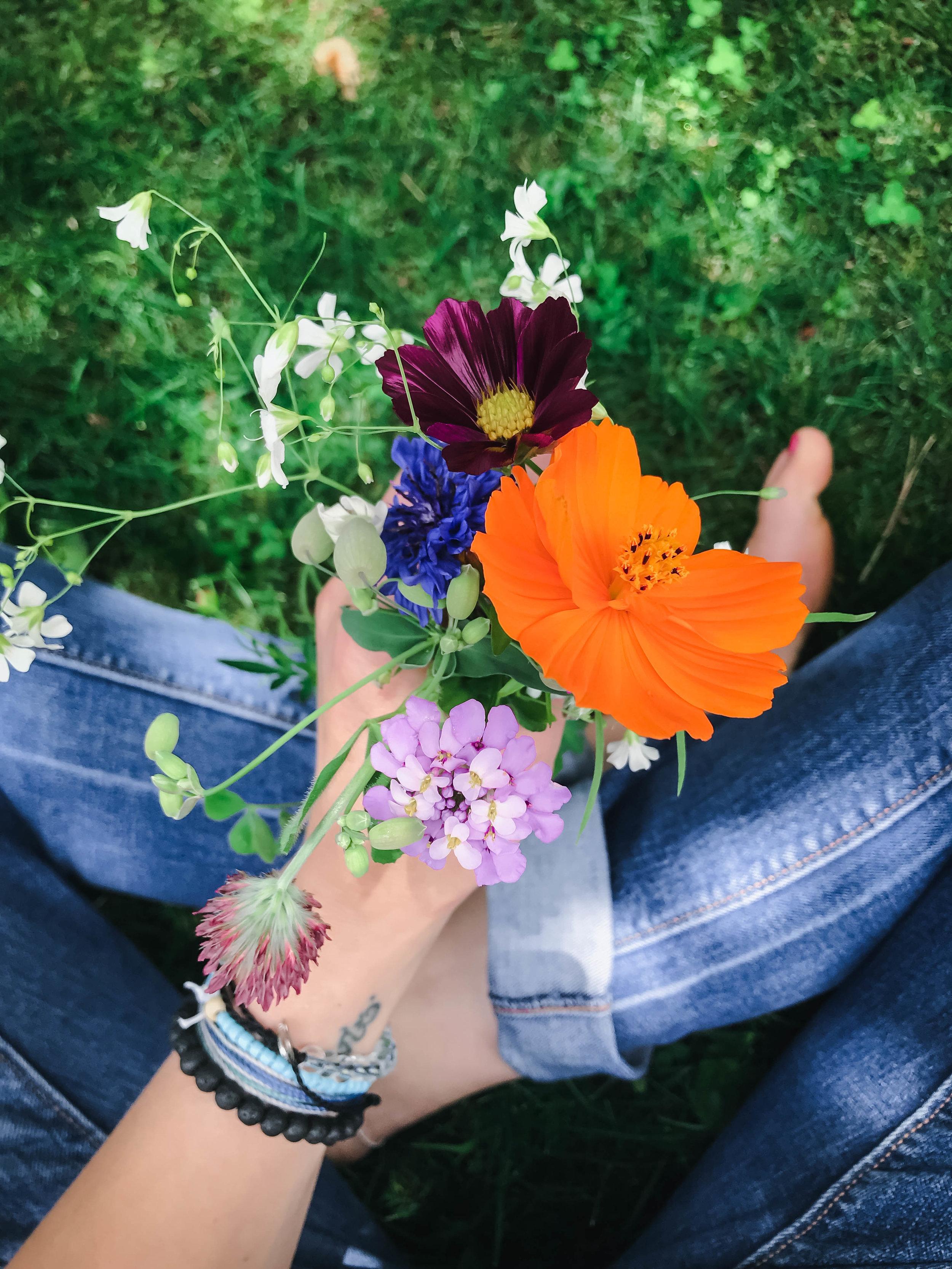flowers being held in hand