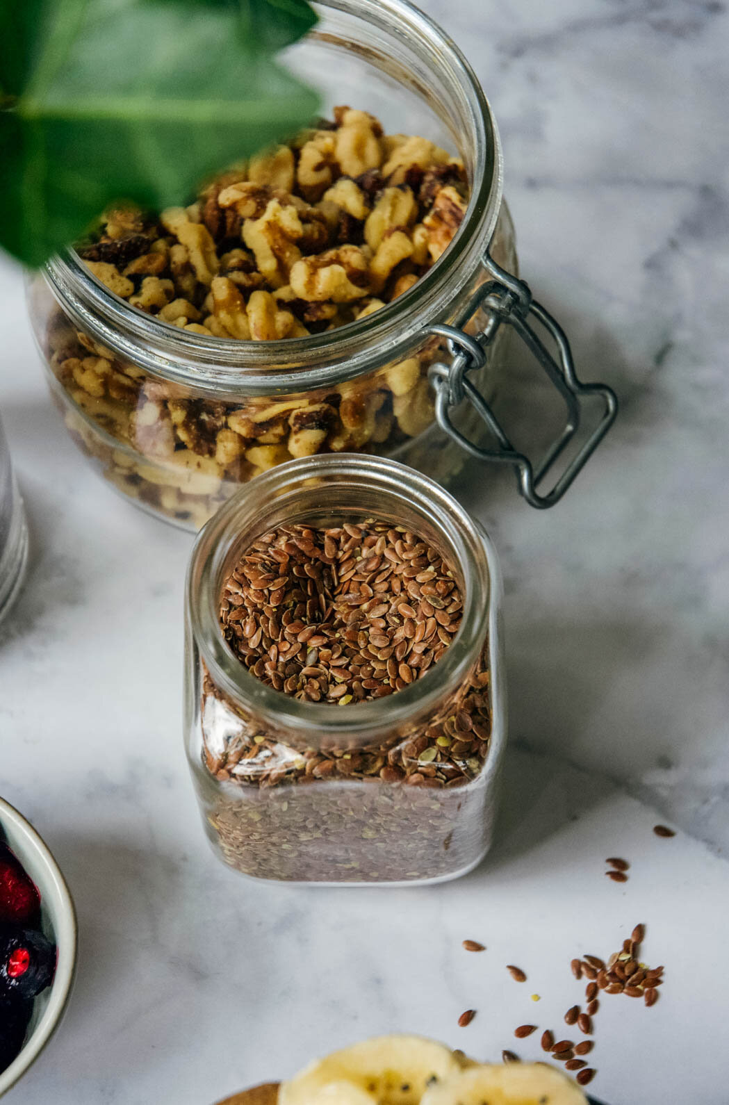 flax seeds and walnuts in jars