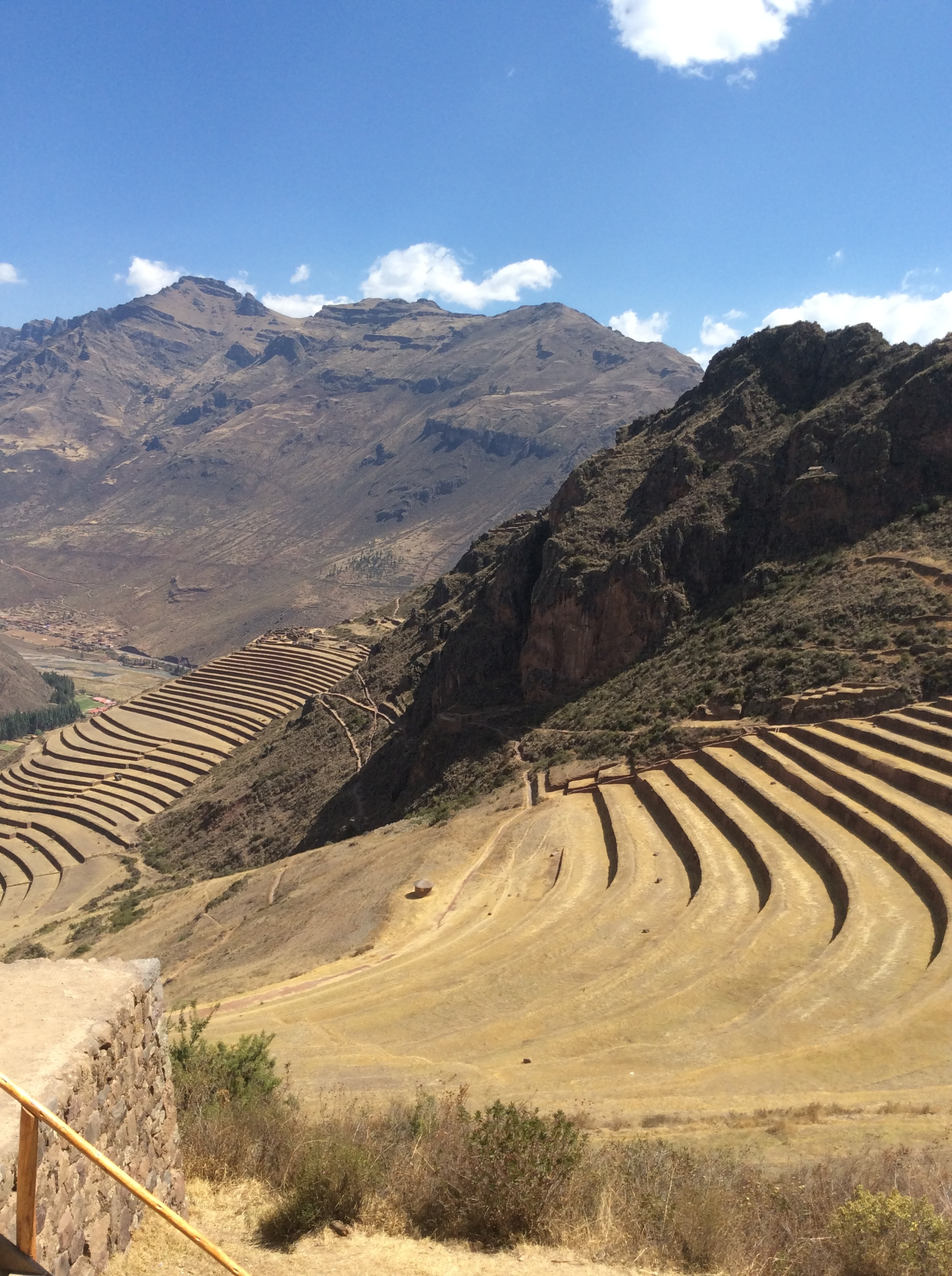 Pisac - (Pictured: The Terraces)   Pisac is perhaps best known for its Incan ruins, known as Inca Písac, which lie atop a hill at the entrance to the valley. The ruins are separated along the ridge into four groups:  P'isaqa ,  Inti Watana ,  Qalla Q'asa , and  Kinchiraqay .  Inti Watana  group includes the Temple of the Sun, baths, altars, water fountains,and a ceremonial platform.  Qalla Q'asa , which is built onto a natural spur and overlooks the valley, is known as the citadel.  The Inca constructed agricultural terraces on the steep hillside, which are still in use today. They created the terraces by hauling richer topsoil by hand from the lower lands. The terraces enabled the production of surplus food, more than would normally be possible at altitudes as high as 11,000 feet.  With military, religious, and agricultural structures, the site served at least a triple purpose. Researchers believe that Písac defended the southern entrance to the Sacred Valley, while Choquequirao defended the western entrance, and the fortress at Ollantaytambo the northern. Inca Pisac controlled a route which connected the Inca Empire with the border of the rain forest.  The sanctuary of  Huanca , site of a sacred shrine, is also near the village. Pilgrims travel to the shrine every September.