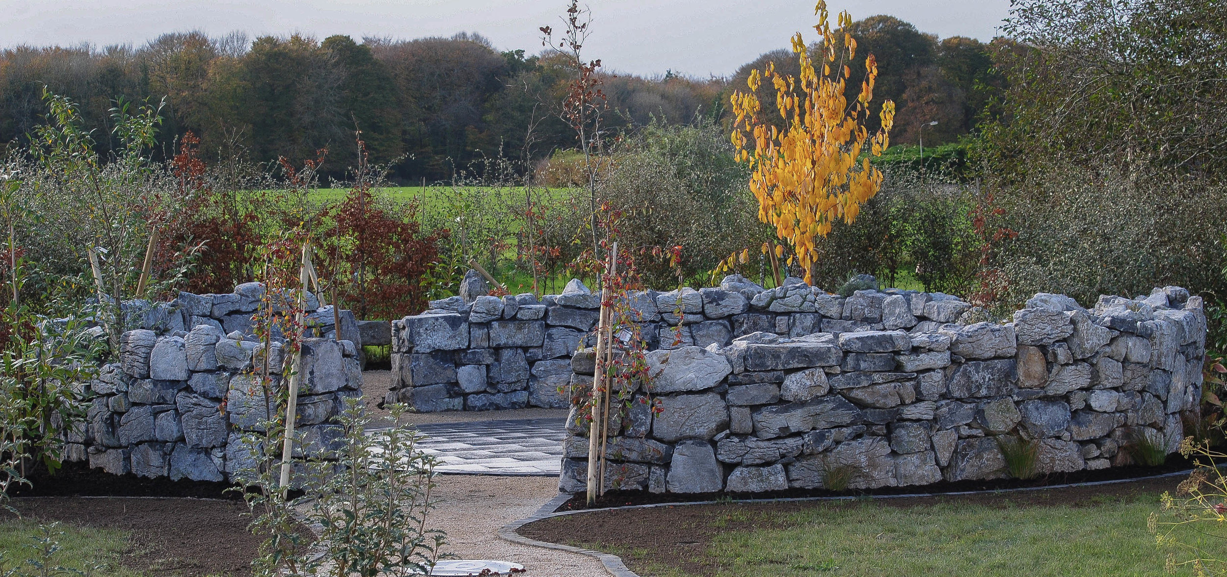 Finishing off the building of the natural stone wall feature.